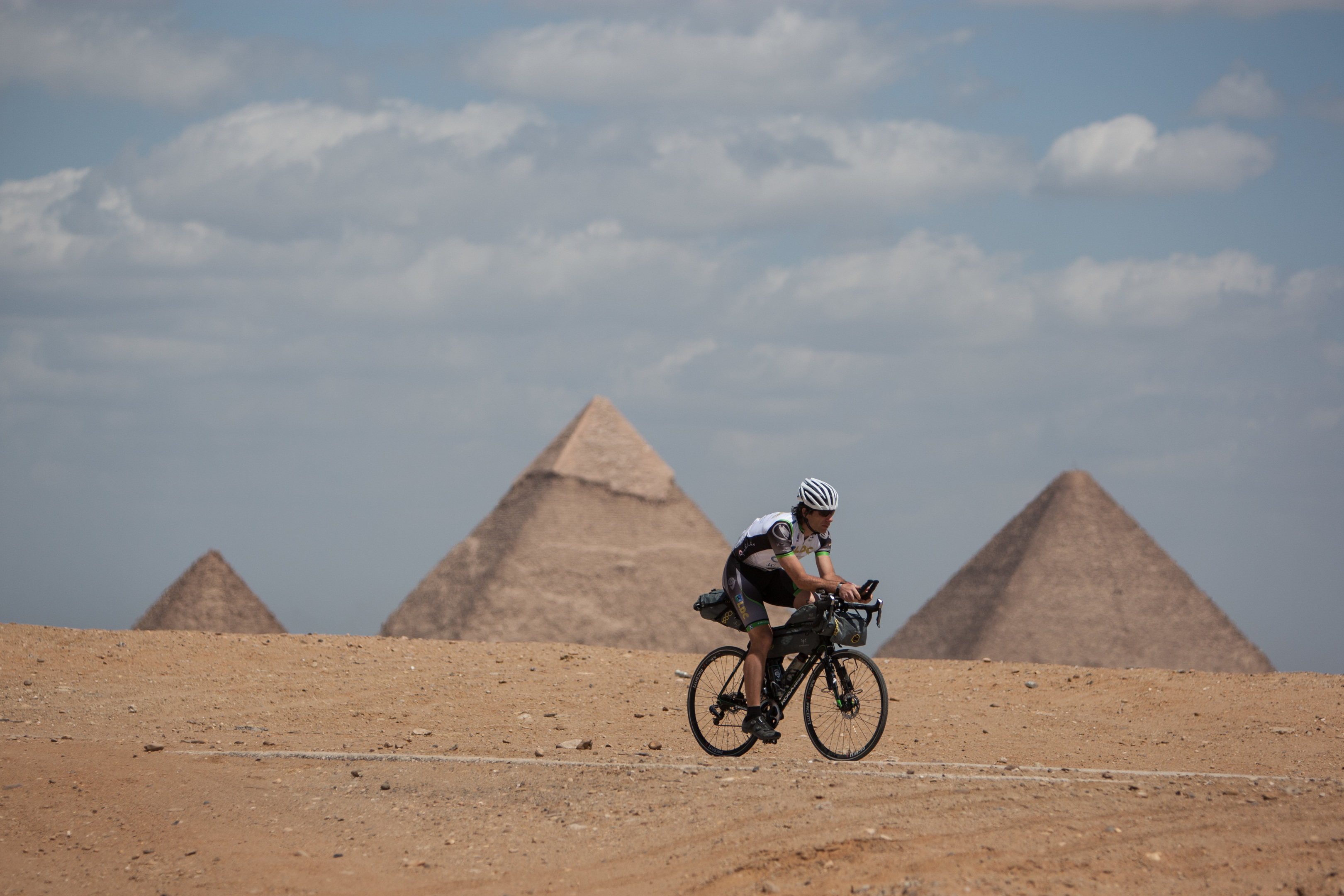 Scottish adventurer Mark Beaumont cycles his Koga bicycle in front of the Pyramids of Giza (Jeremy Sutton-Hibbert)