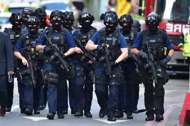 Armed police being deployed near the Borough Market attack (Dominic Lipinski/PA)