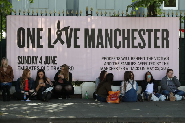 Youngsters wait to attend Sunday's One Love benefit concert for victims of the Manchester terror attack (Owen Humphreys/PA)