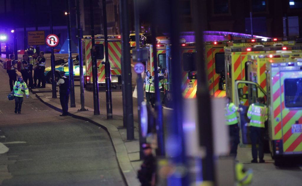 Emergency personnel on London Bridge as police are dealing with a