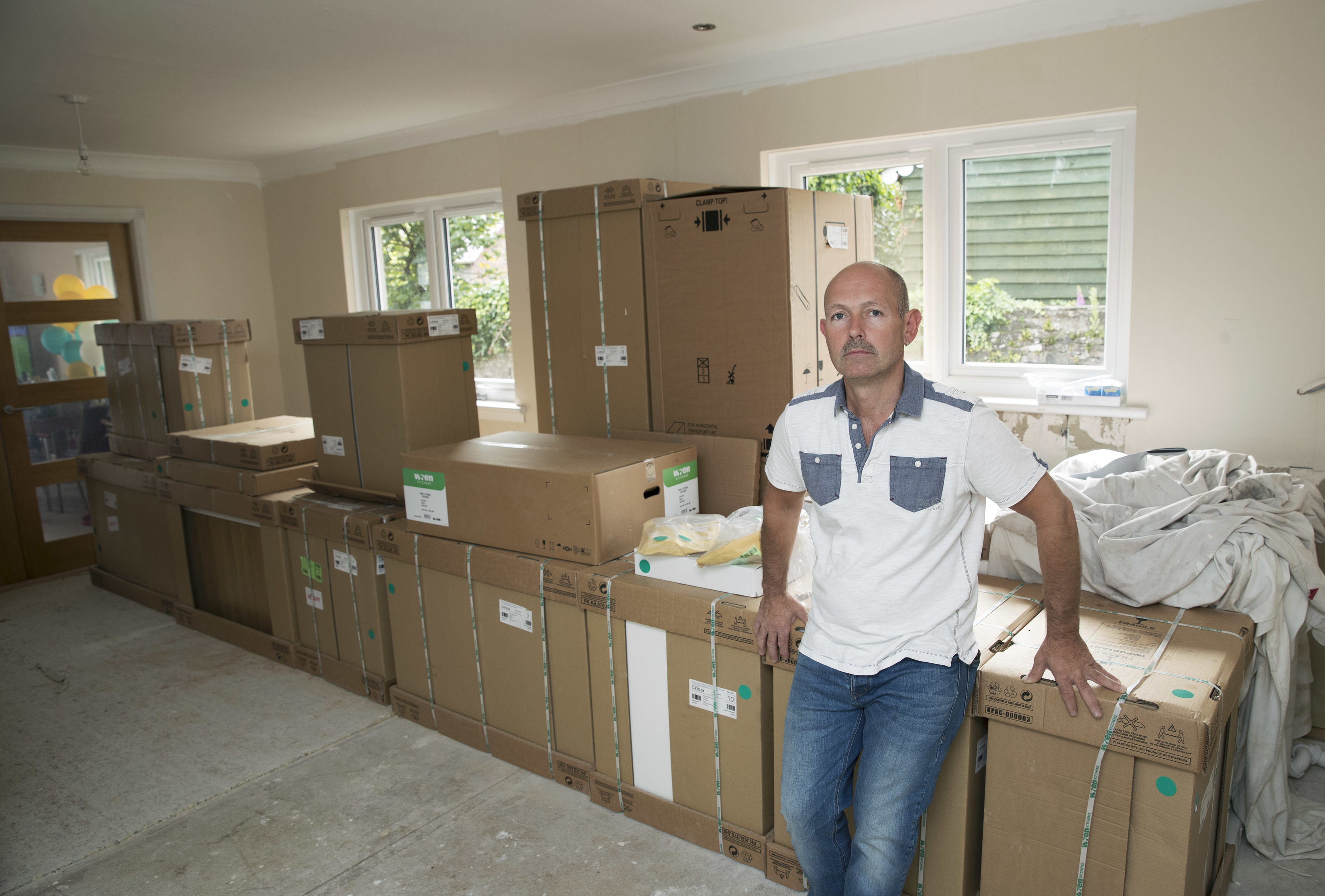 Andrew MacDonald from Crieff has been left with boxes of units he insists he didn't order (Graeme Hart / Perthshire Picture Agency)