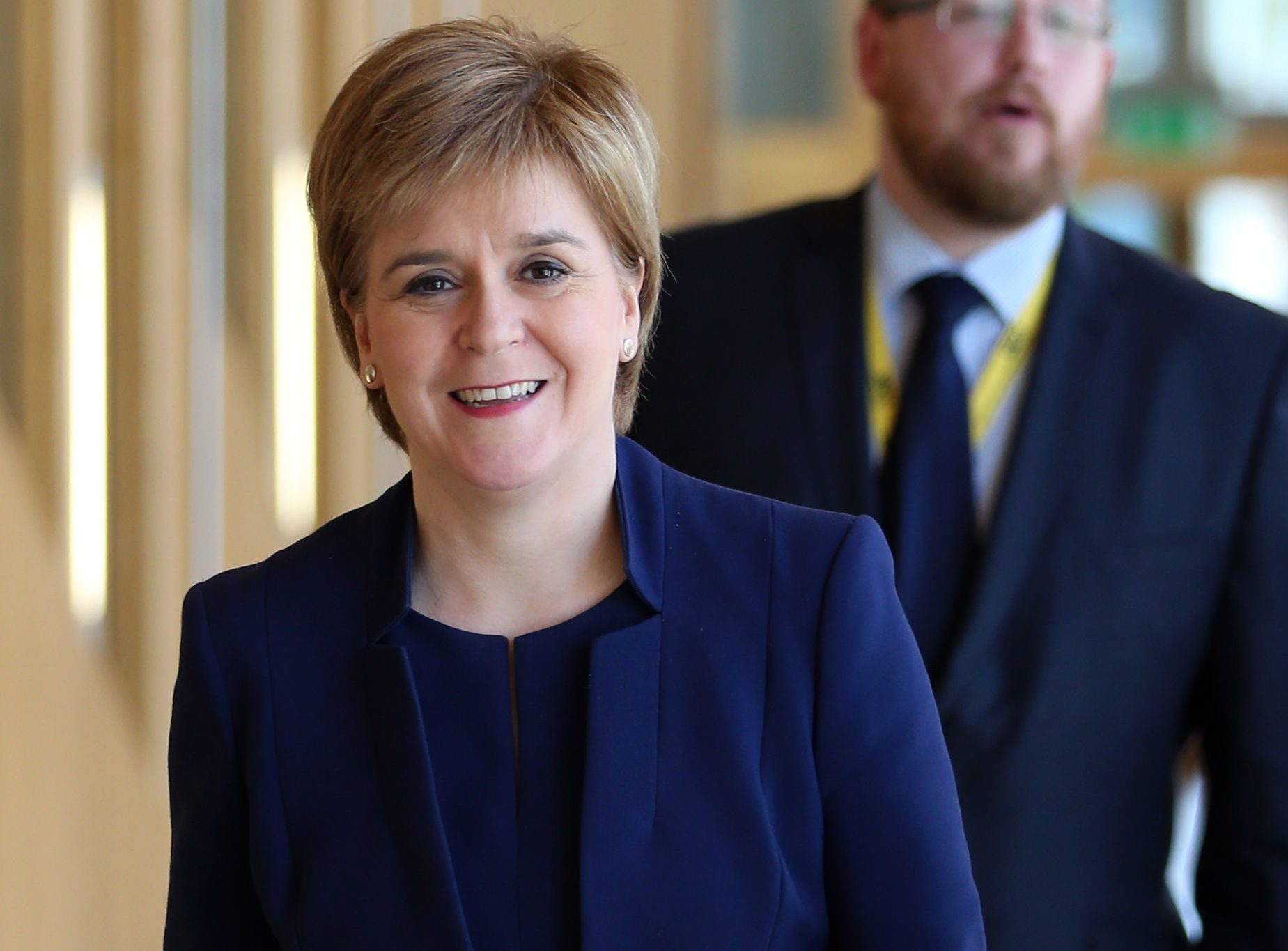 First Minister Nicola Sturgeon arrives ahead of First Minister's Questions at the Scottish Parliament in Edinburgh. (Jane Barlow/PA Wire)