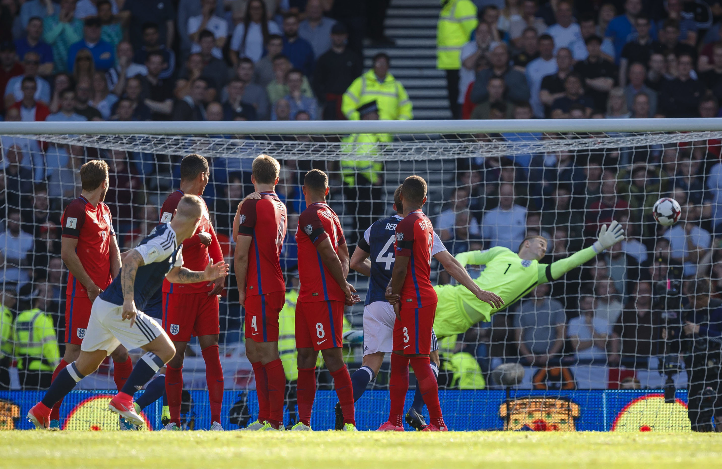 Scotland's Leigh Griffiths scores a free kick for his side (SNS)