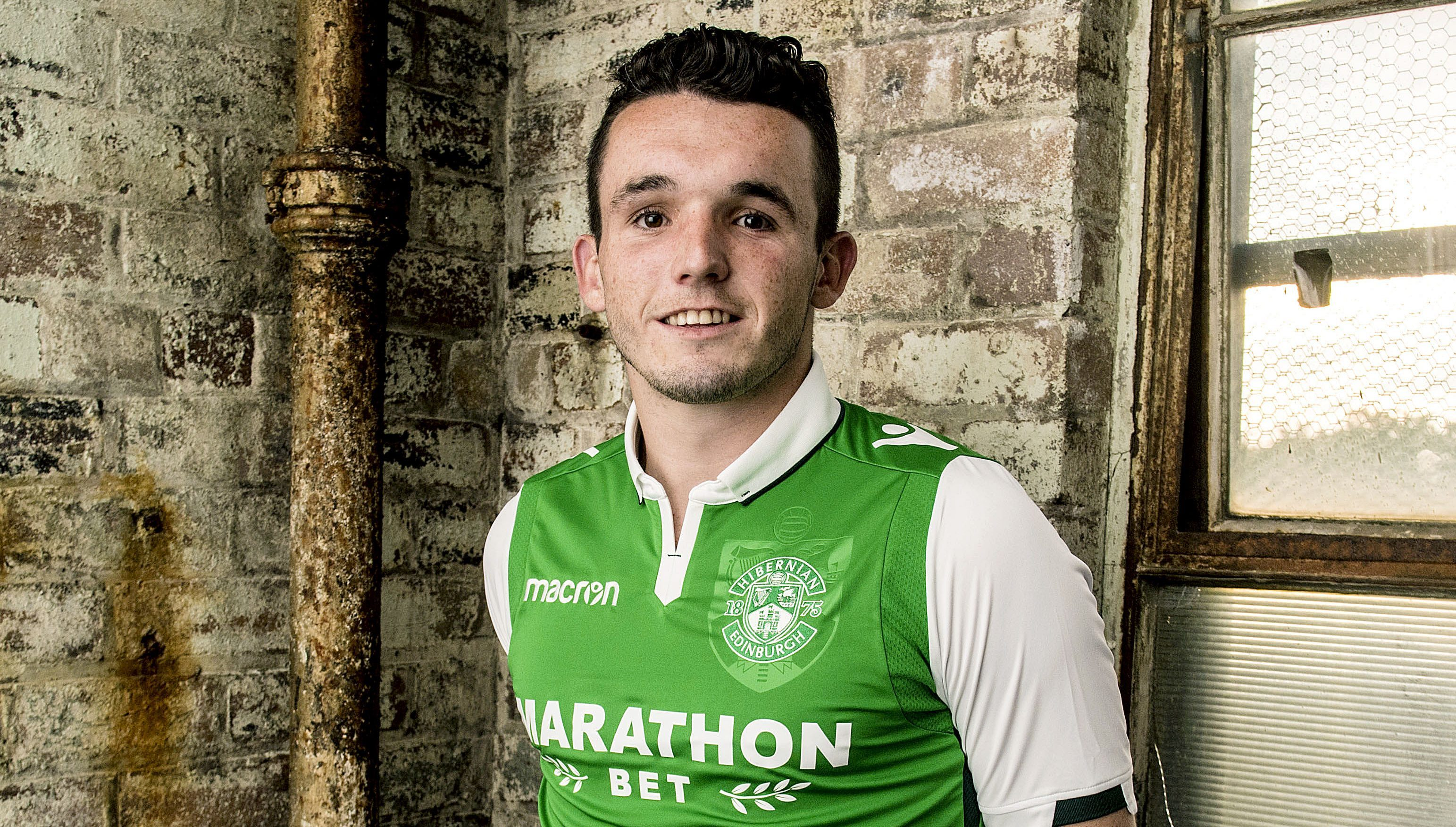 John McGinn models Hibernian's new home kit for next season (SNS Group)
