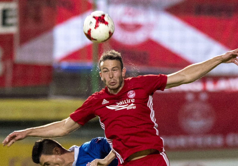 Aberdeen's Andrew Considine heads clear