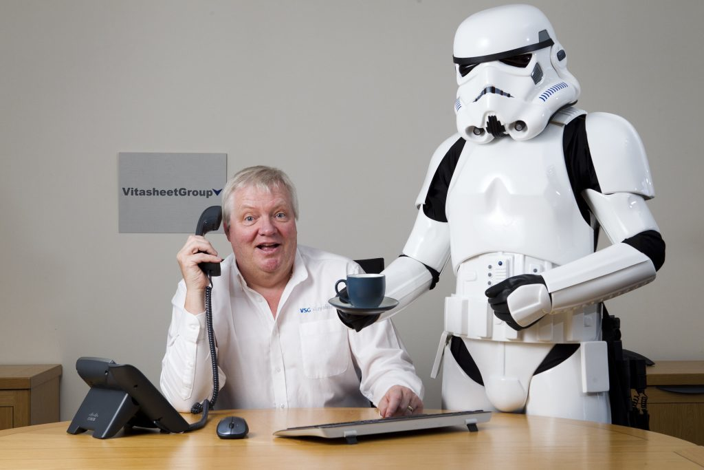 Tom Harkins, director at Vita Sheet Group, with a Star Wars Stormtrooper (reporter John Paul Breslin in costume) (Andrew Cawley, Sunday Post).