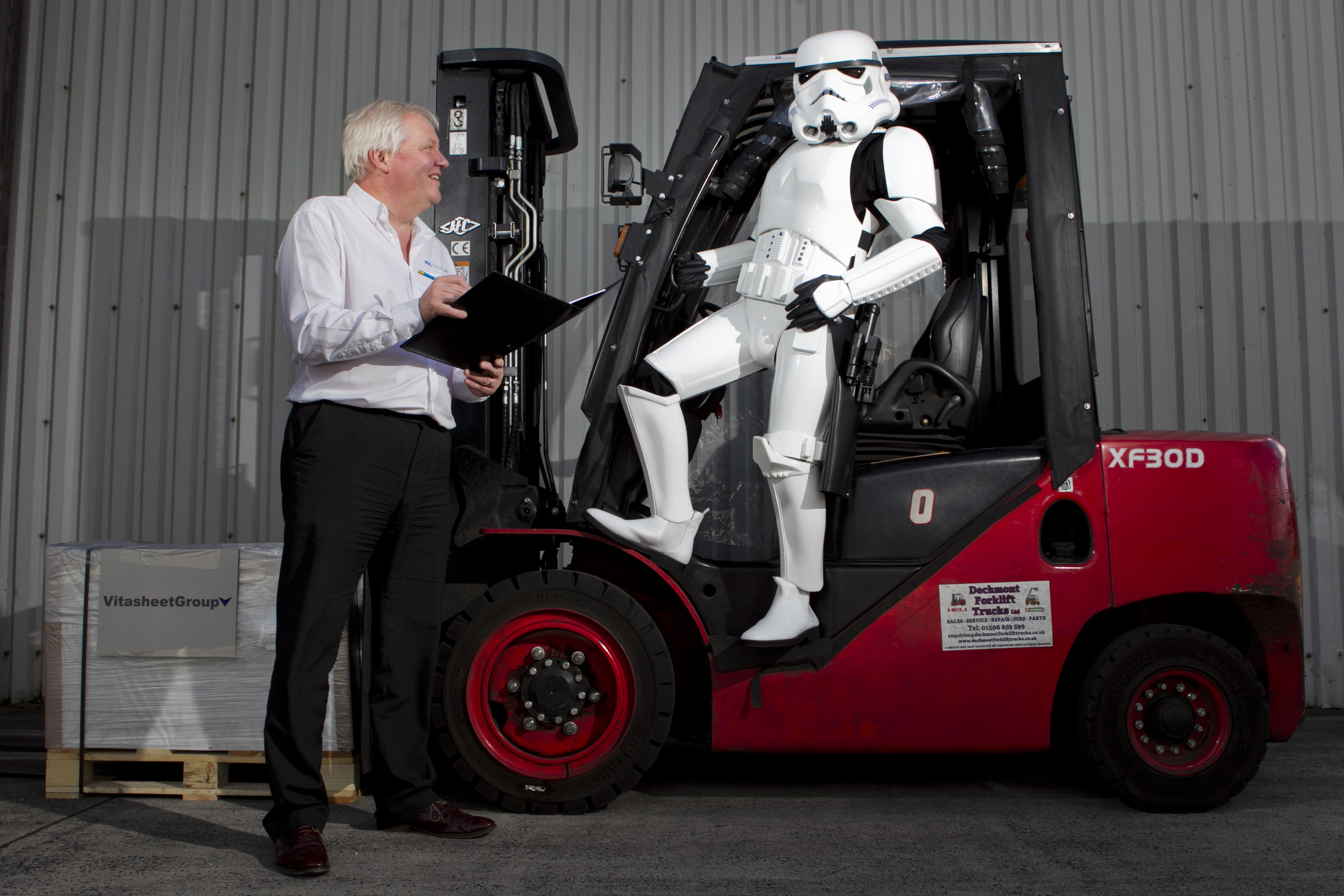 Tom Harkins, director at Vita Sheet Group, with a Star Wars Stormtrooper (reporter John Paul Breslin in costume) - The company supplied the plastic used to make the Stormtrooper outfits for the original Star Wars films. (Andrew Cawley, Sunday Post)