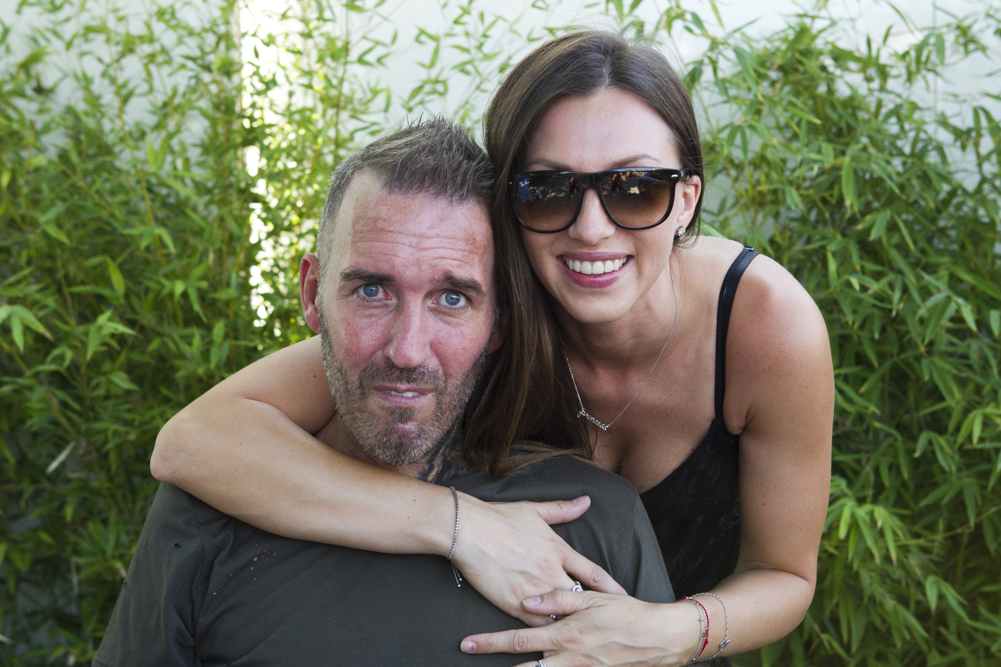 Former Rangers player, Fernando Ricksen (who has MND), with his wife Veronica, being presented with a birthday present from the Sunday Post, before he goes to his birthday party at the Ibrox Bar in Benidorm (Andrew Cawley, Sunday Post)