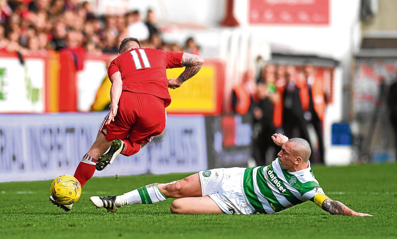 Celtic's Scott Brown (right) tackles Jonny Hayes last season (SNS Group)