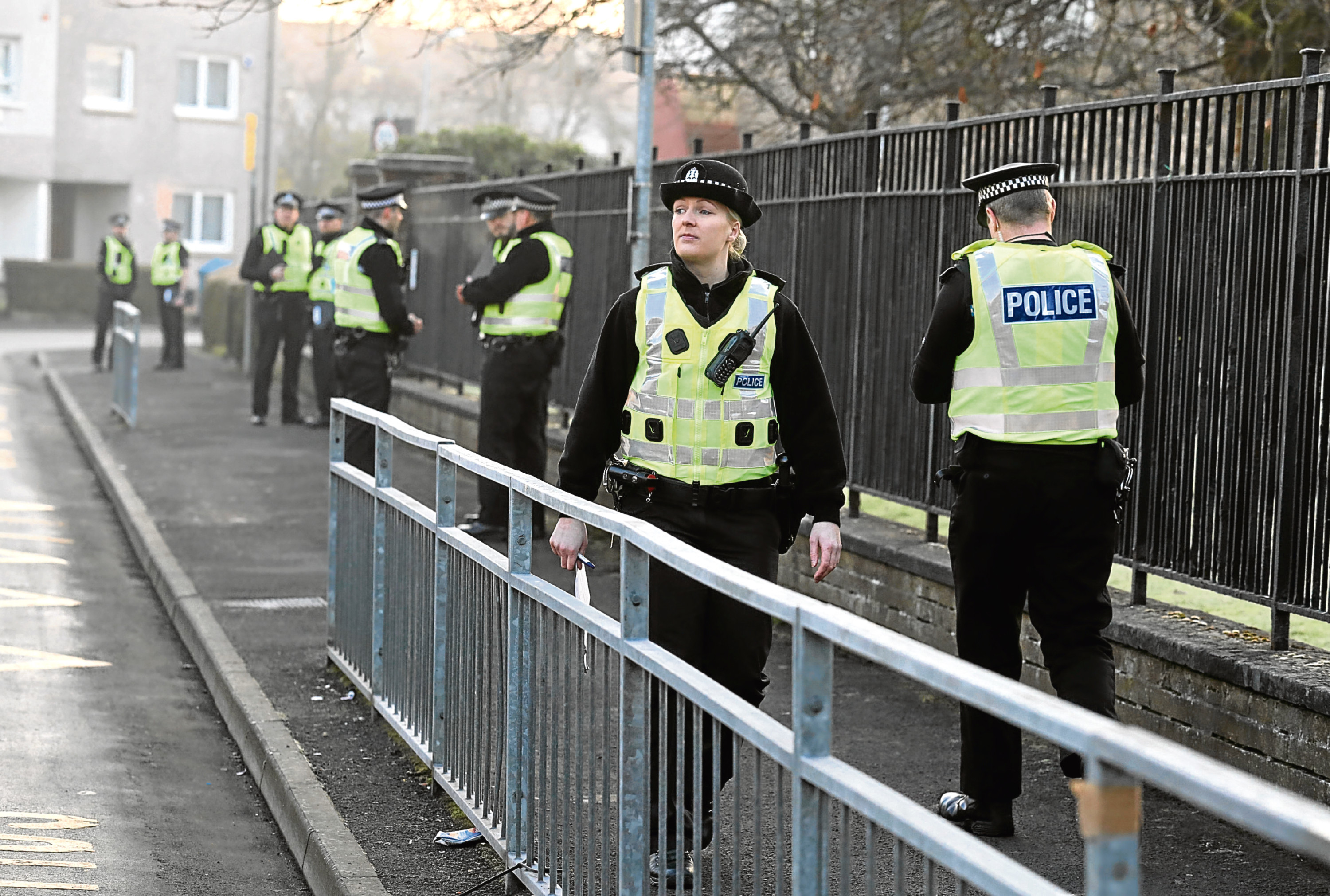 Police officers investigating an attempted murder near St George's Primary School in Penilee, Glasgow, January 2017 (Andrew Milligan/PA Wire)