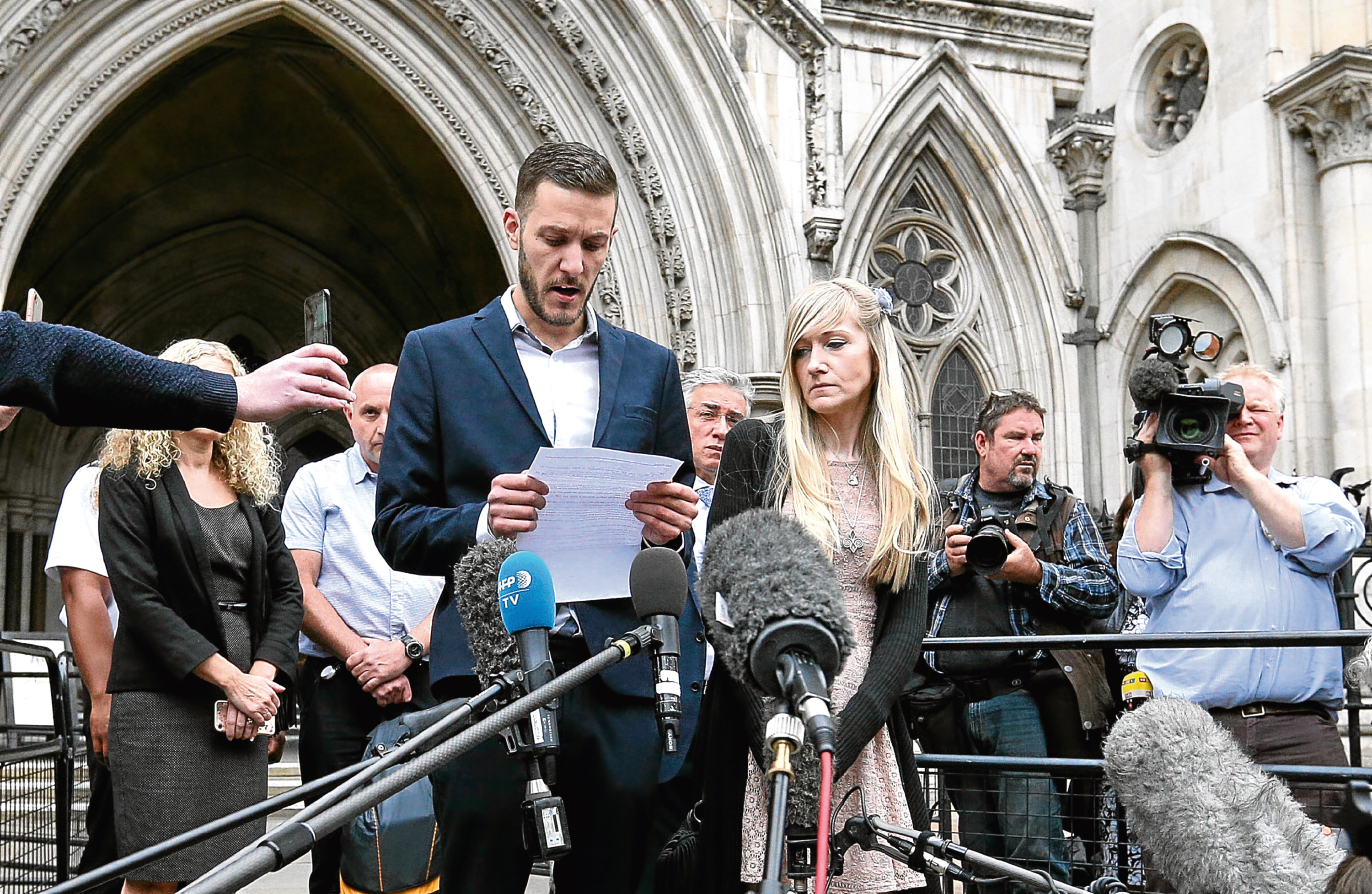 Charlie Gard's parents Chris Gard and Connie Yates speak to the media outside the High Court, London, after they ended their legal fight over treatment for the terminally-ill baby. (Jonathan Brady/PA Wire)