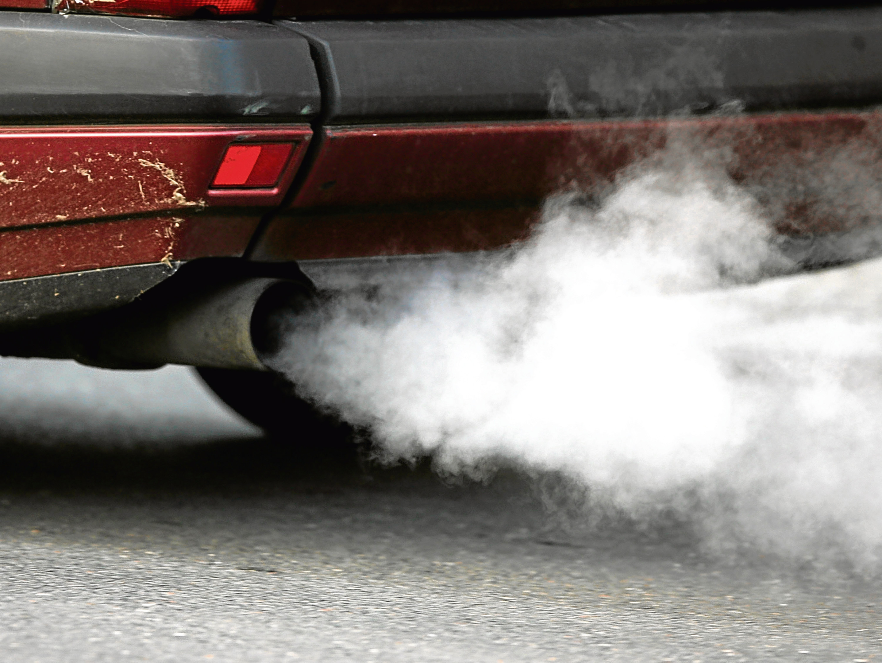 A vehicle's exhaust pipe releases fumes (Andreas Rentz/Getty Images)