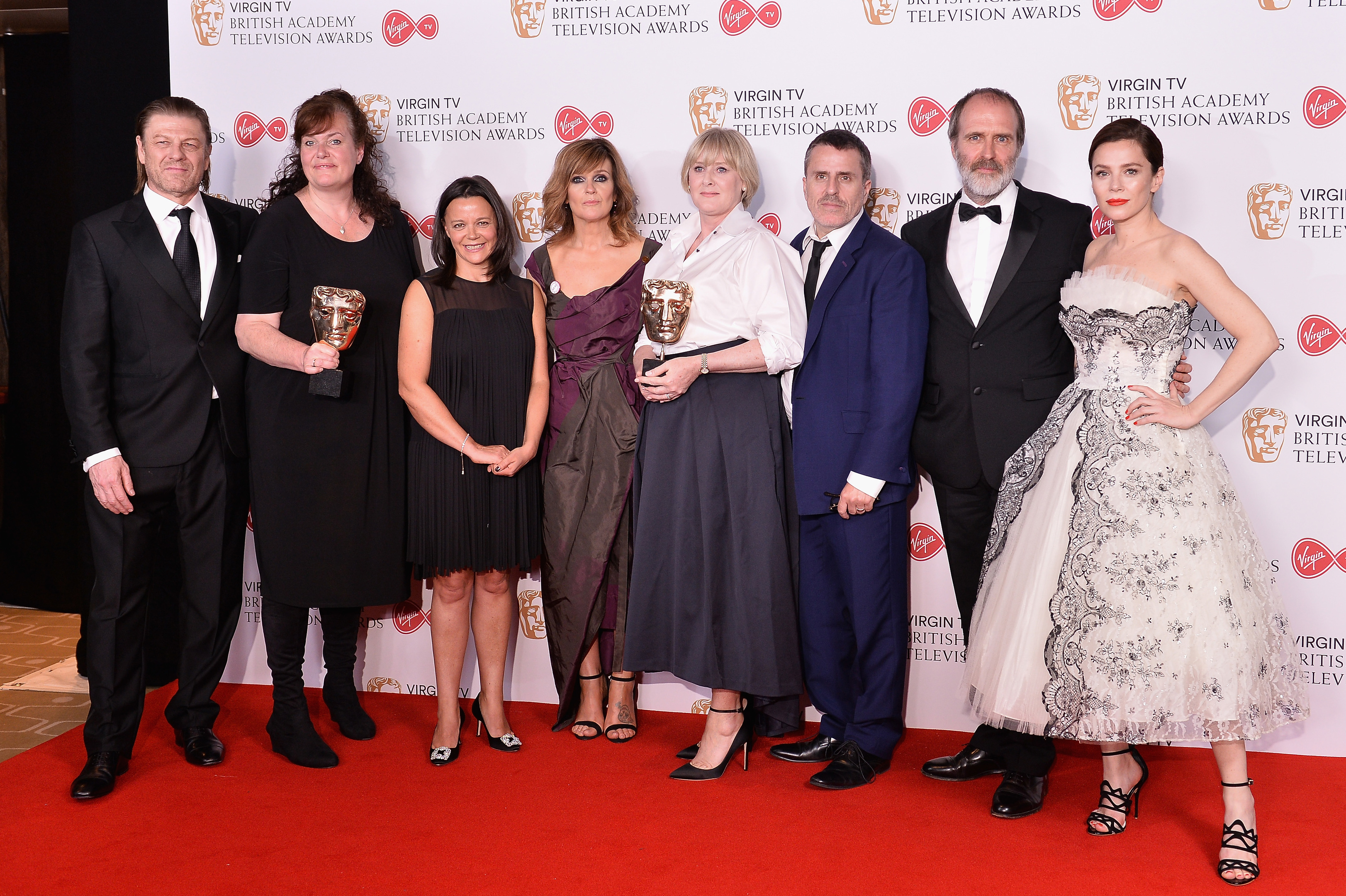 Sean Bean, Sally Wainwright, Juliet Charlesworth, Siobhan Finneran, Nicola Shindler, Neasa Hardiman and Anna Friel pose with the award for Drama Series, Happy Valley in the Winner's room at the Virgin TV BAFTA Television Awards (Jeff Spicer/Getty Images)