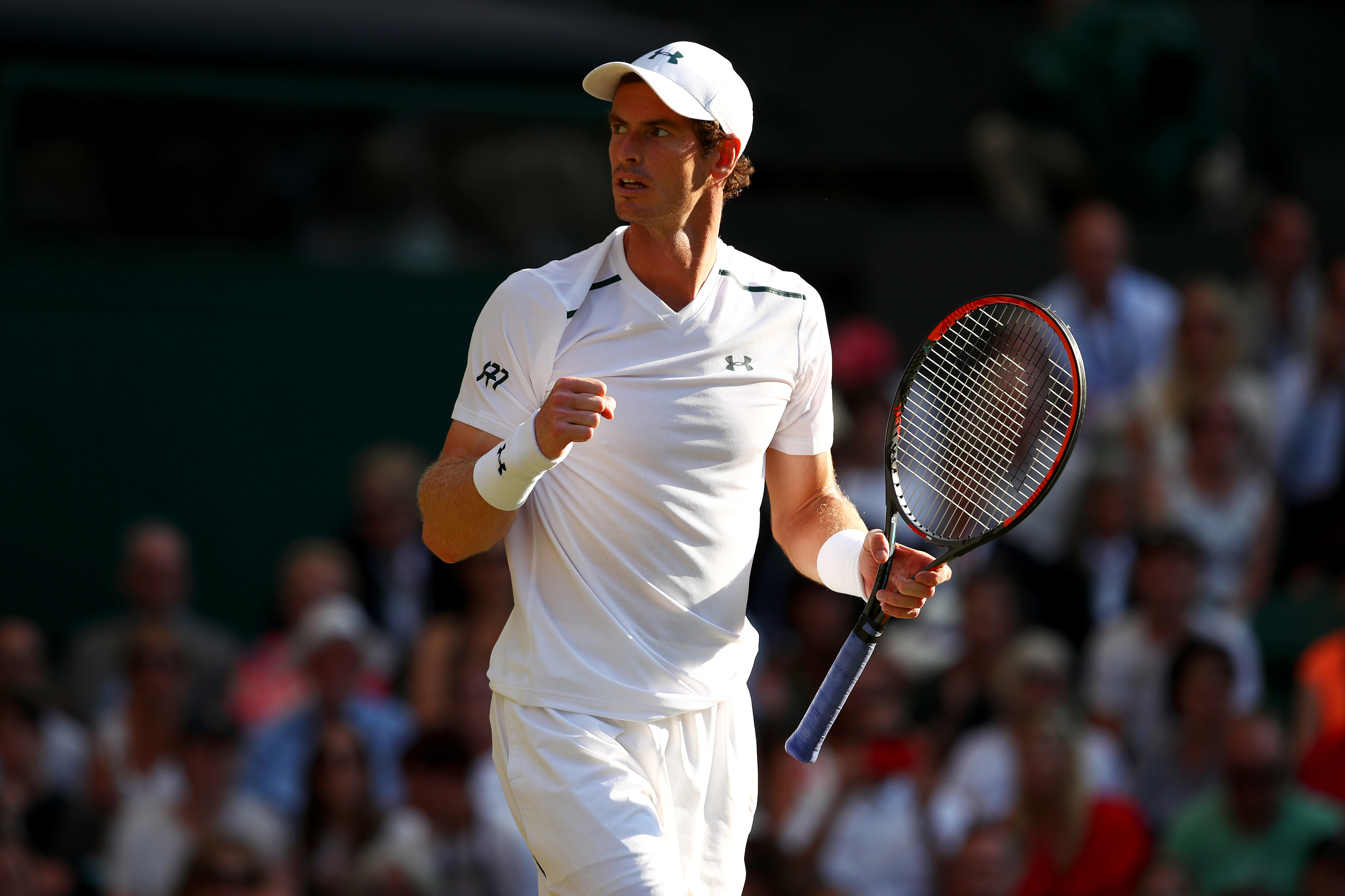 Andy Murray celebrates victory after his Gentlemen's Singles second round match against Dustin Brown of Germany on day three of Wimbledon (Clive Brunskill/Getty Images)