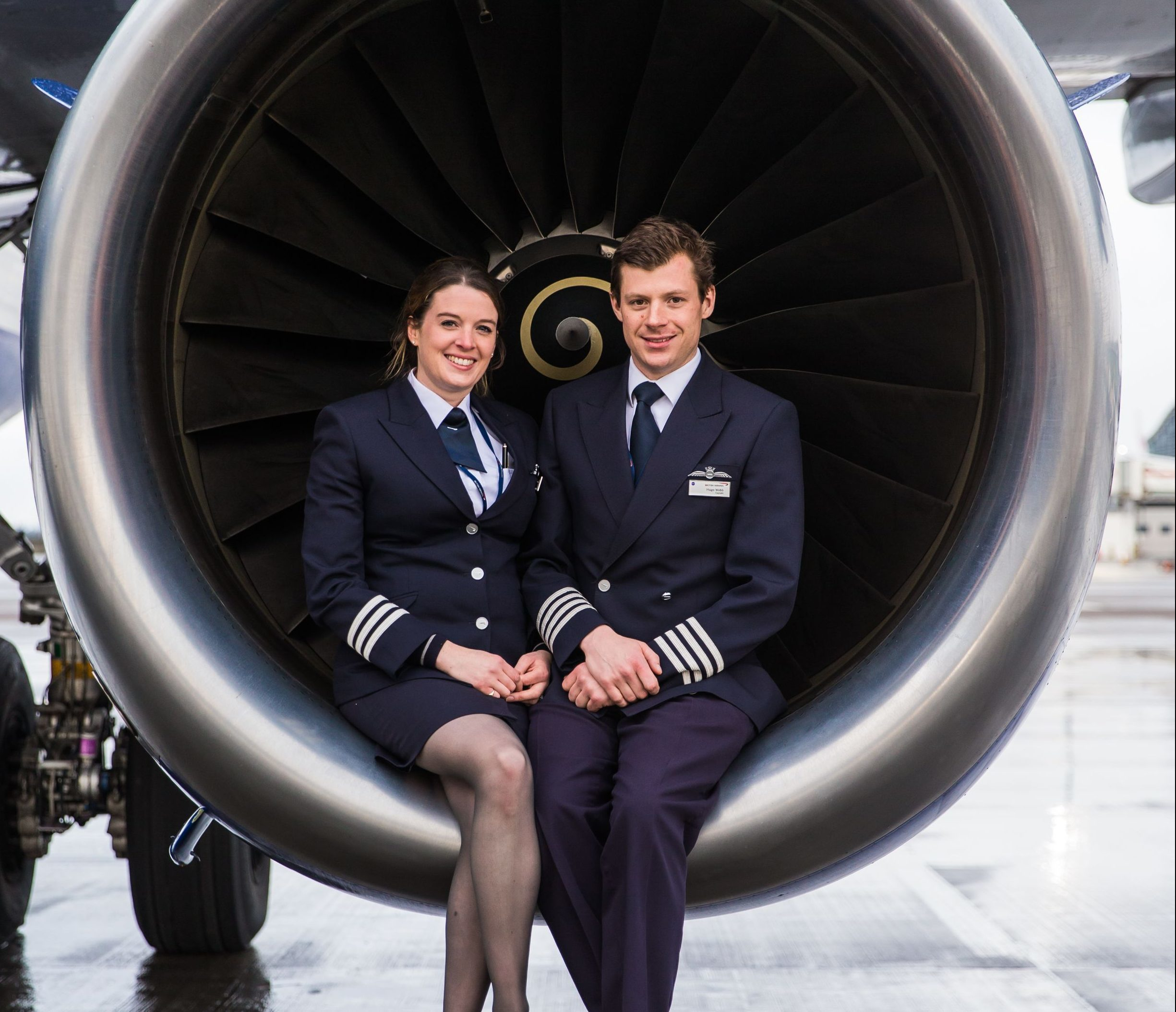 Hugo and Hannah Webb, who pilot British Airways flights together and have described how sharing a cockpit helps their relationship. (Stuart Bailey/British Airways/PA Wire)