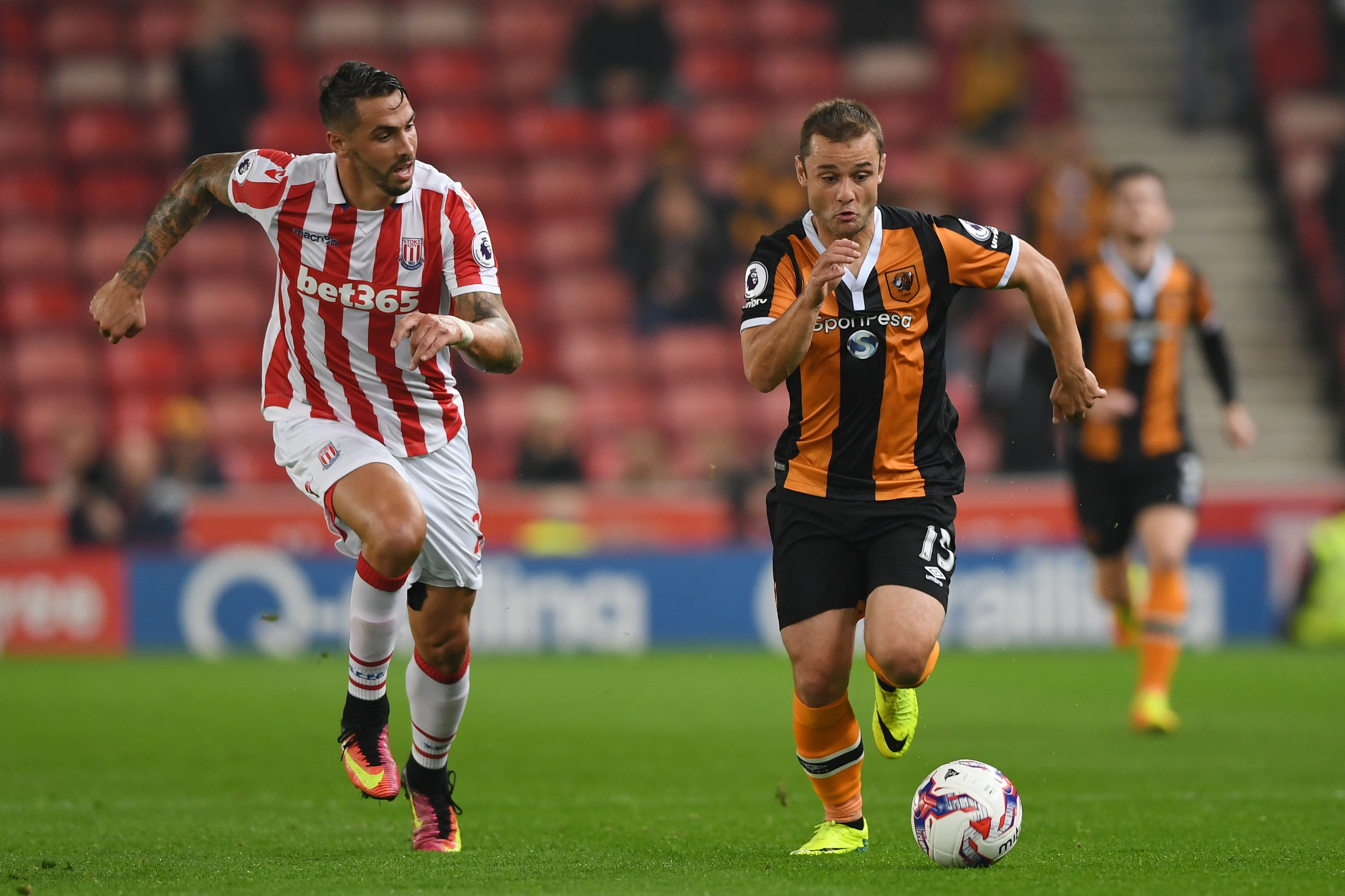 Shaun Maloney of Hull City and Geoff Cameron of Stoke City in action  (Gareth Copley/Getty Images)