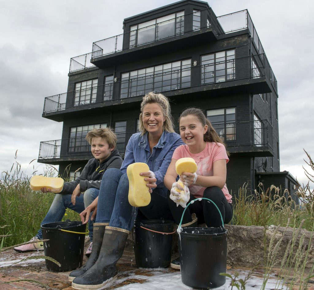 Charlotte Seddon and her kids Albert (8) and Agnes (10) get ready to clean the 76 windows of their house (Trevor Martin)