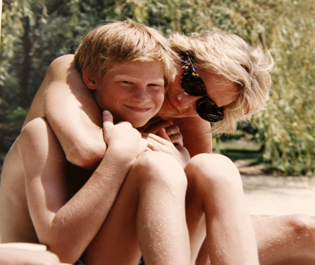 This photograph released by Kensington Palace, from the personal photo album of the late Diana, Princess of Wales, shows the princess and Prince Harry on holiday and features in the new ITV documentary 'Diana, Our Mother: Her Life and Legacy', which airs on ITV at 21.00hrs on Monday 24th July. Diana Pictures. (The Duke of Cambridge and Prince Harry)