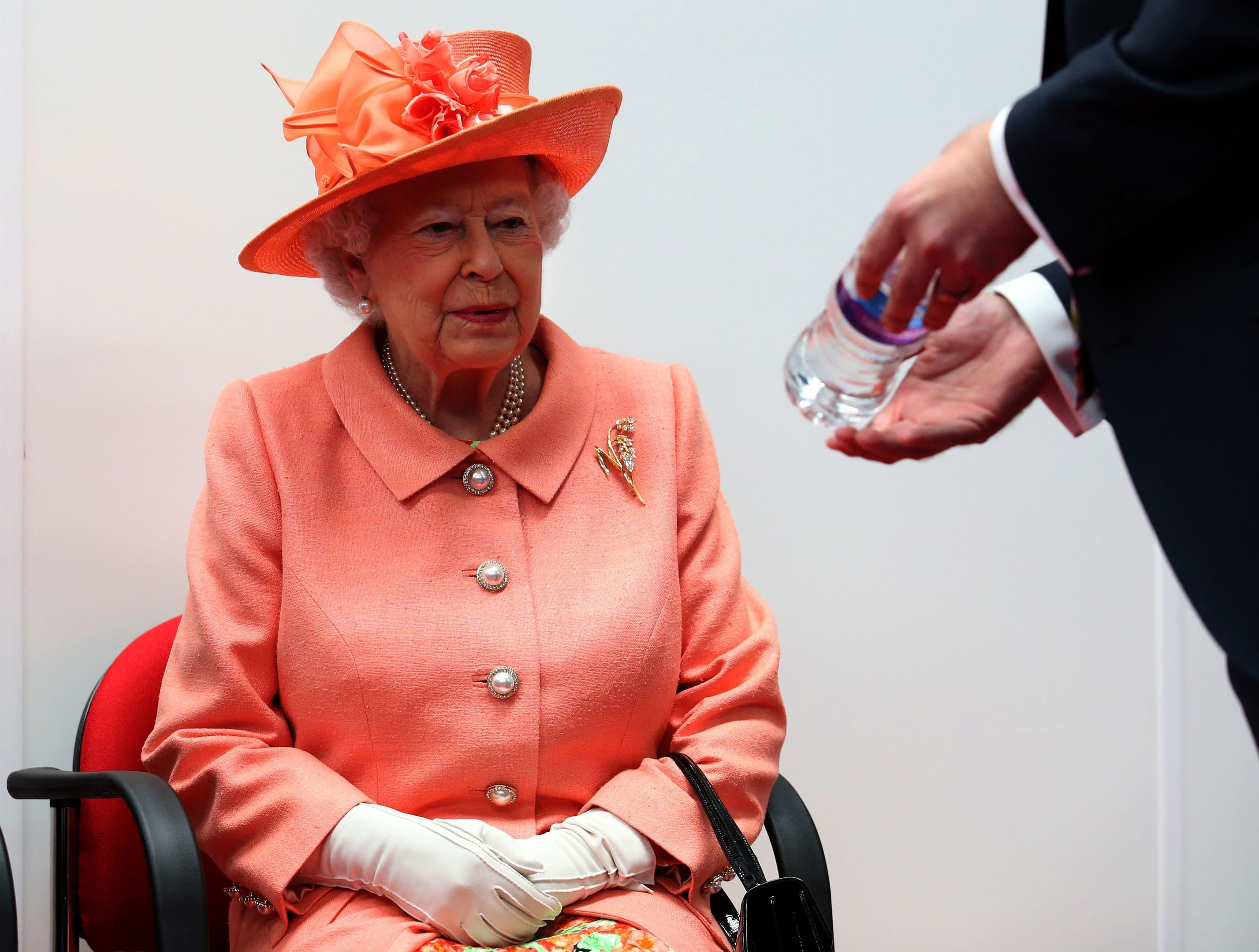Queen Elizabeth II is shown a bottle of Highland Spring with her name on it after it was produced to commemorate her visit, during a visit to the new Highland Spring factory building in Blackford near Stirling. (Andrew Milligan/PA Wire)