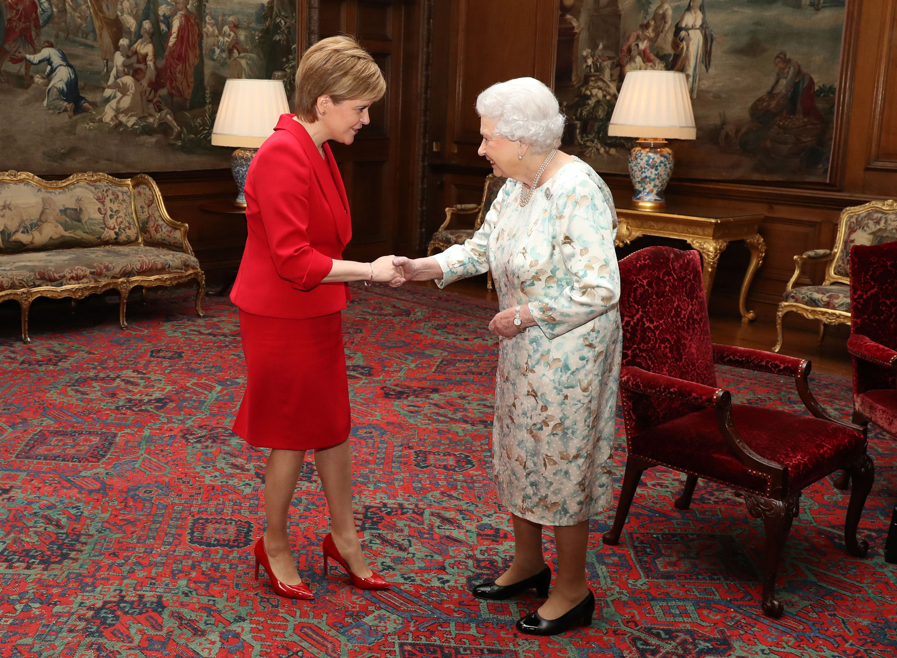 Queen Elizabeth II (right) greets Scotland's First Minister Nicola Sturgeon at an audience at the Palace of Holyroodhouse in Edinburgh. (Andrew Milligan/PA Wire)