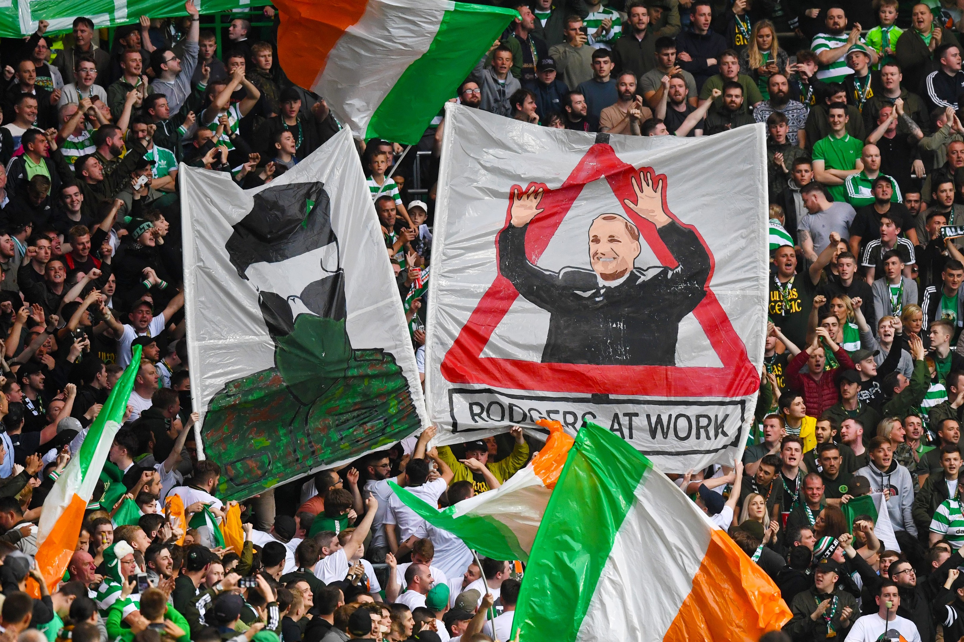 Banners in the Celtic crowd against Linfield (SNS Group)