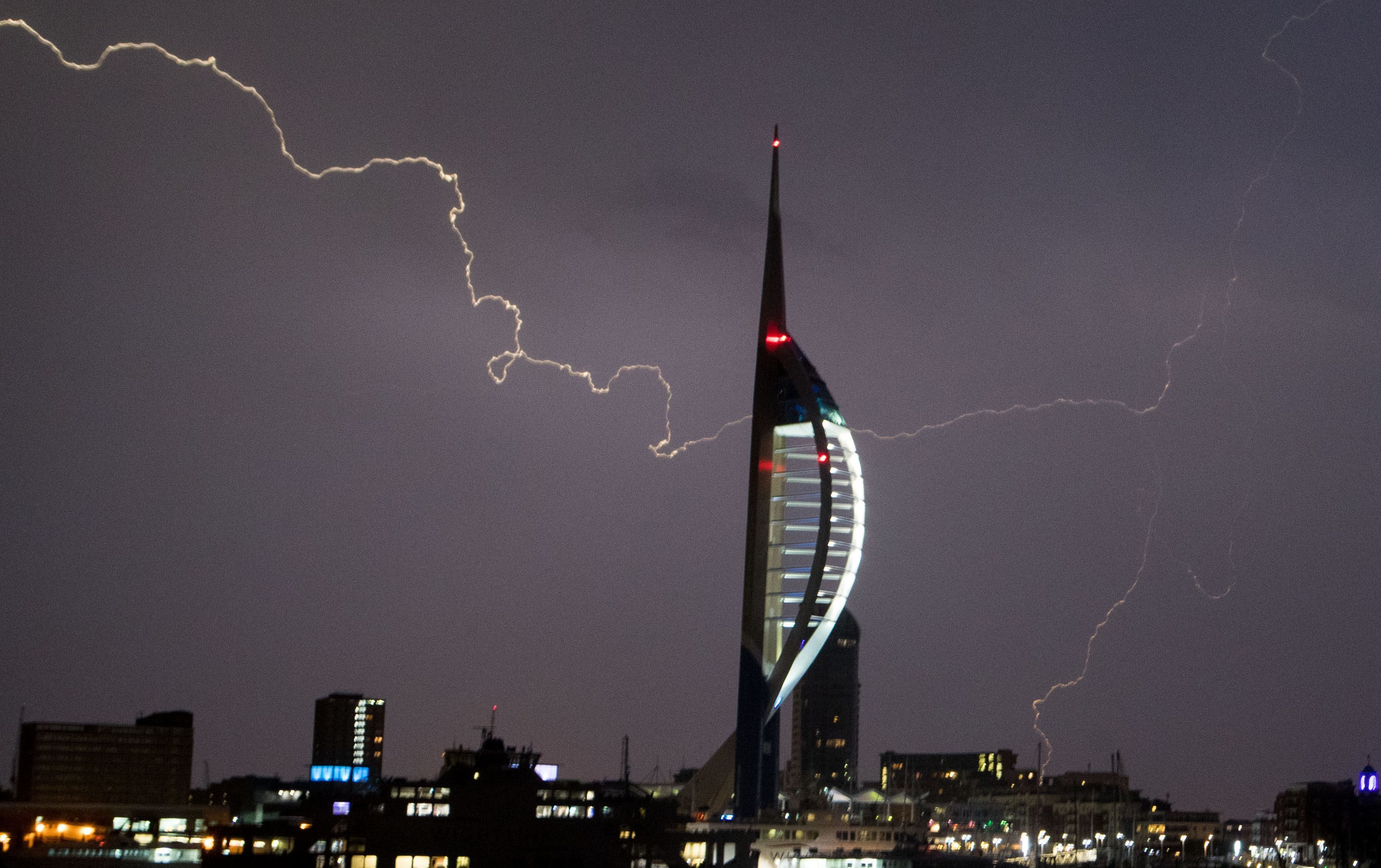 Lightning flashes near the Spinnaker Tower in Portsmouth (Steve Parsons/PA Wire)