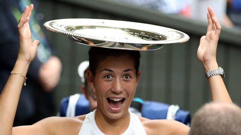 Garbine Muguruza won the women's title yesterday (PA)