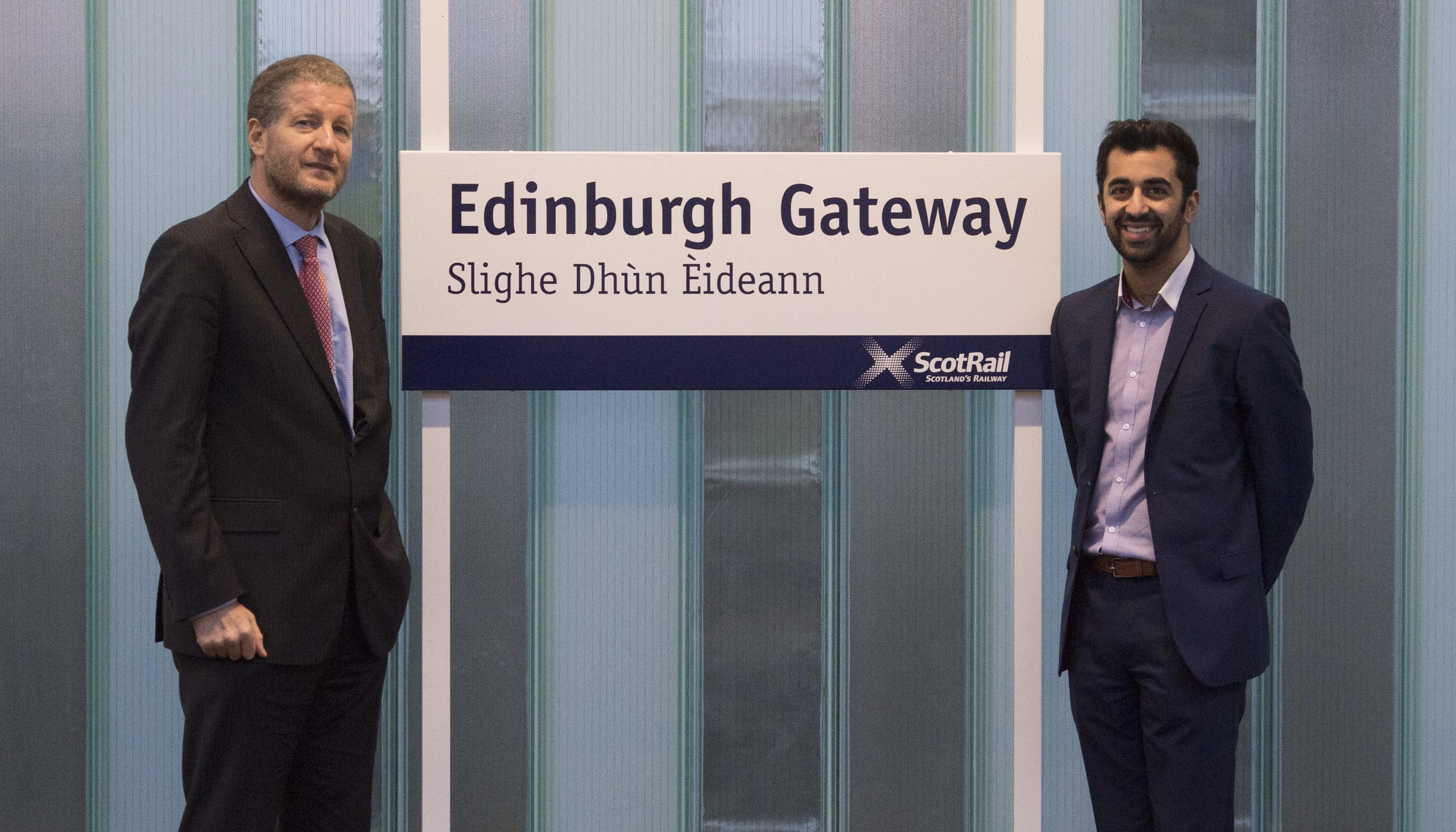 Former Scotrail Alliance managing director Phil Verster (left) joins Transport Minister Humza Yousaf as the Edinburgh Gateway Station is officially opened (PA)