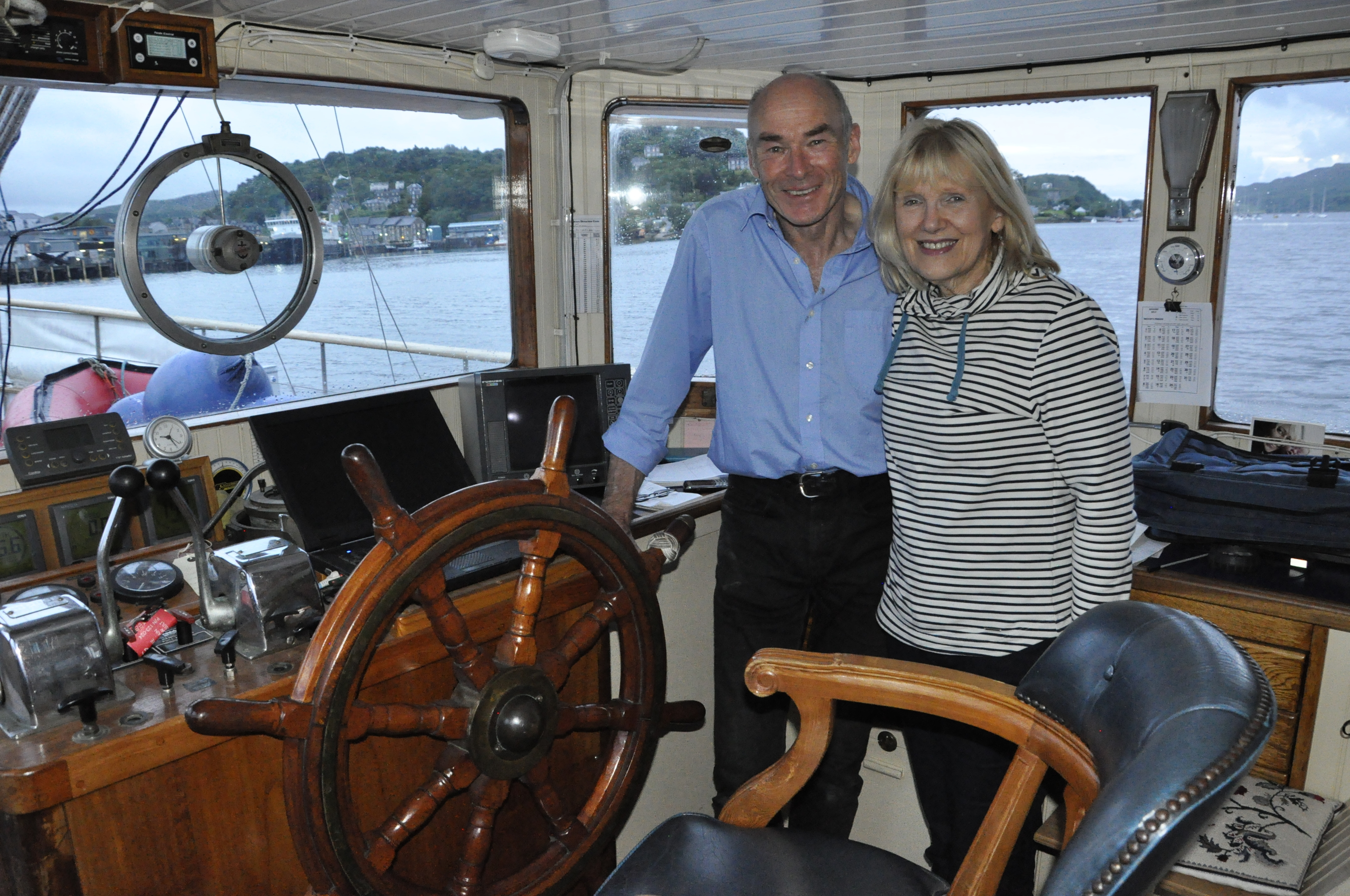 Gus and Sue at the wheel (Oban Times)