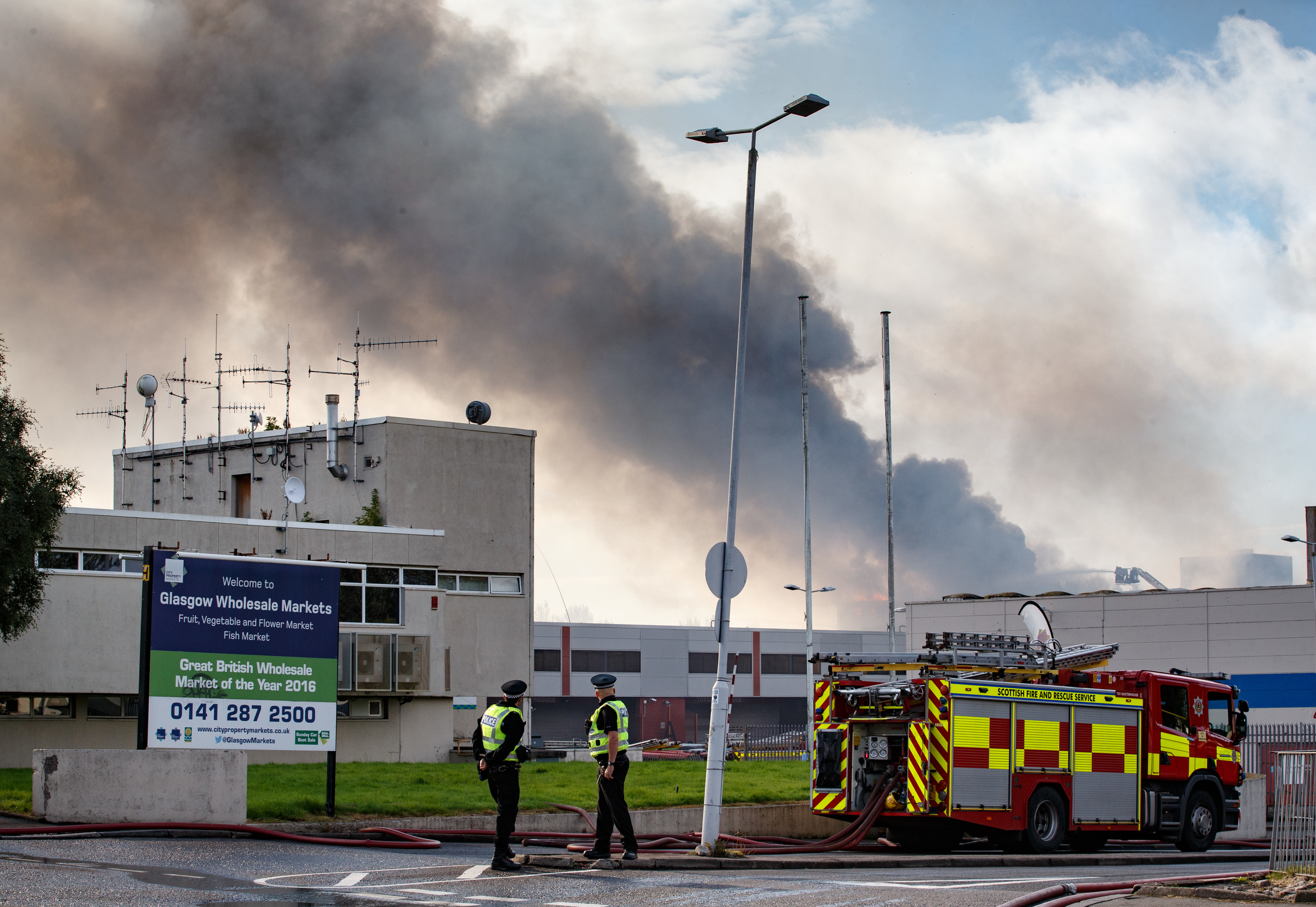 Firefighters attend the scene of a blaze at Blochairn Fruitmarket (Robert Perry/Getty Images)