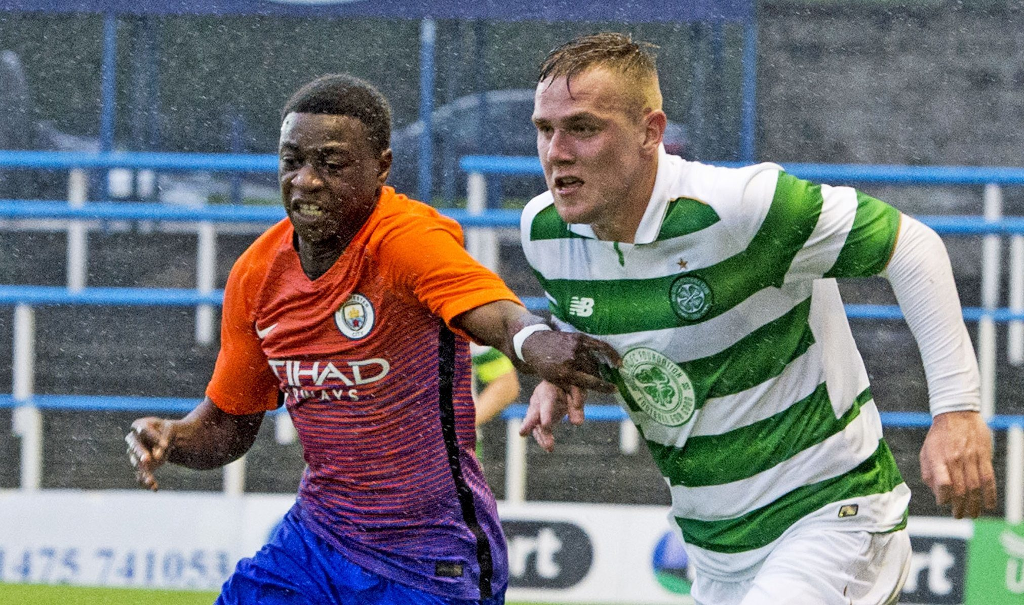 Manchester City youngster Aaron Nemane (left) in action against Celtic's youth team last year (SNS Group / Paul Devlin)