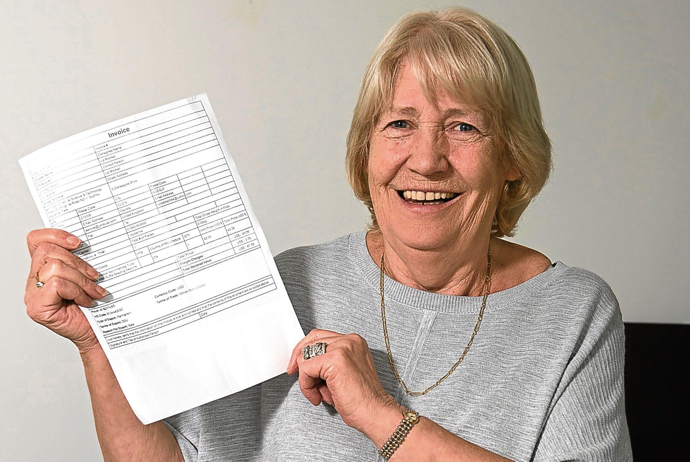 Liz Mitchell from Elgin with her refund (Trevor Martin)