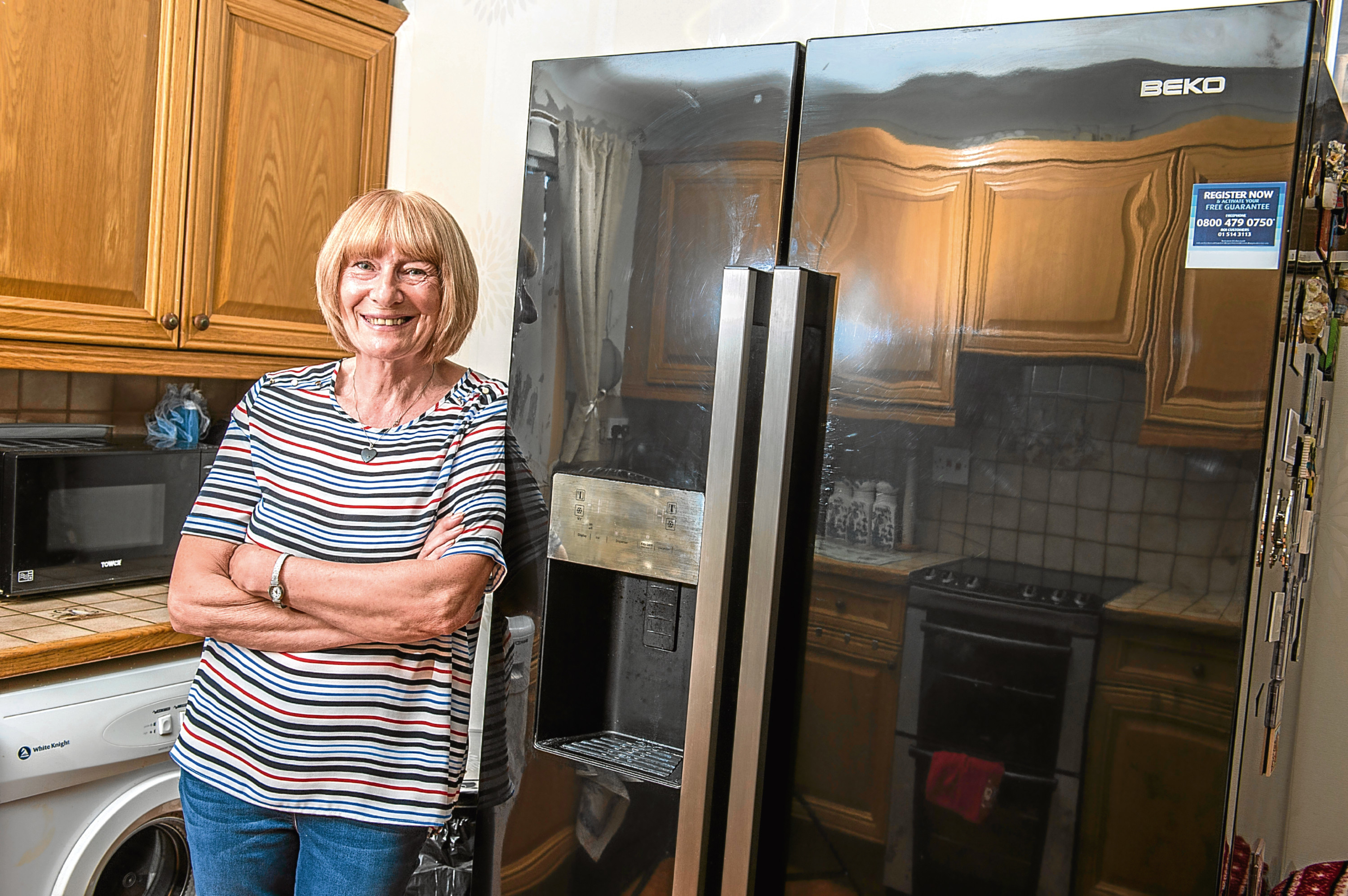 Carol Avill from Campsall in Doncaster, who has finally got her BEKO fridge freezer fixed after encountering major faults with it (Dean Atkins)