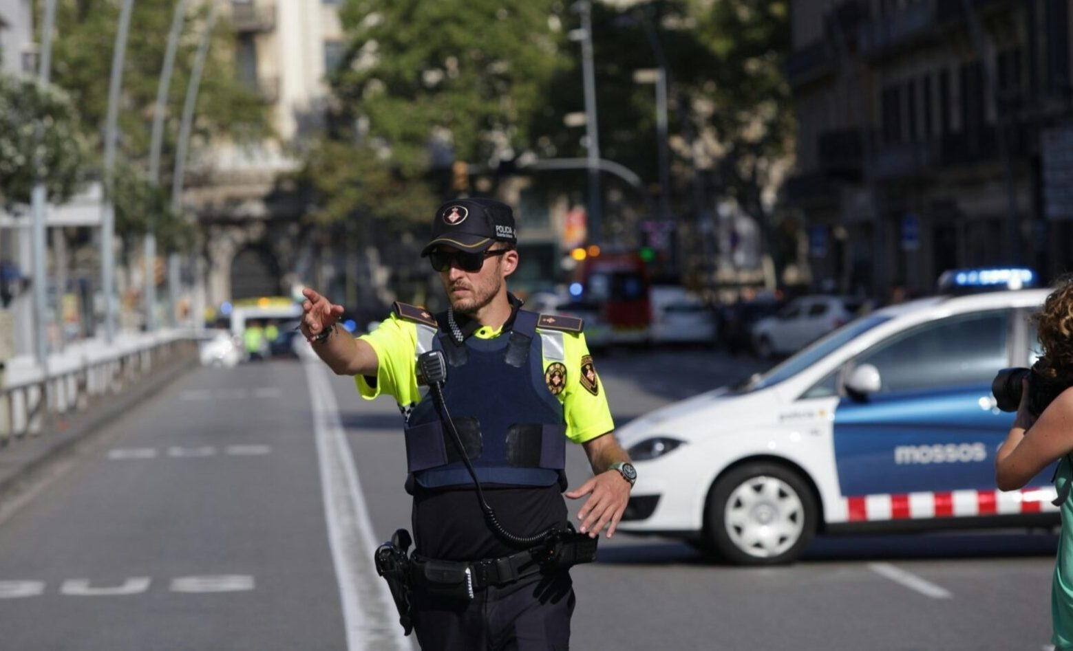 A police officer blocks the traffic after a van plowed into the crowd, injuring several people in Barcelona, ( Albert Llop/Anadolu Agency/Getty Images)