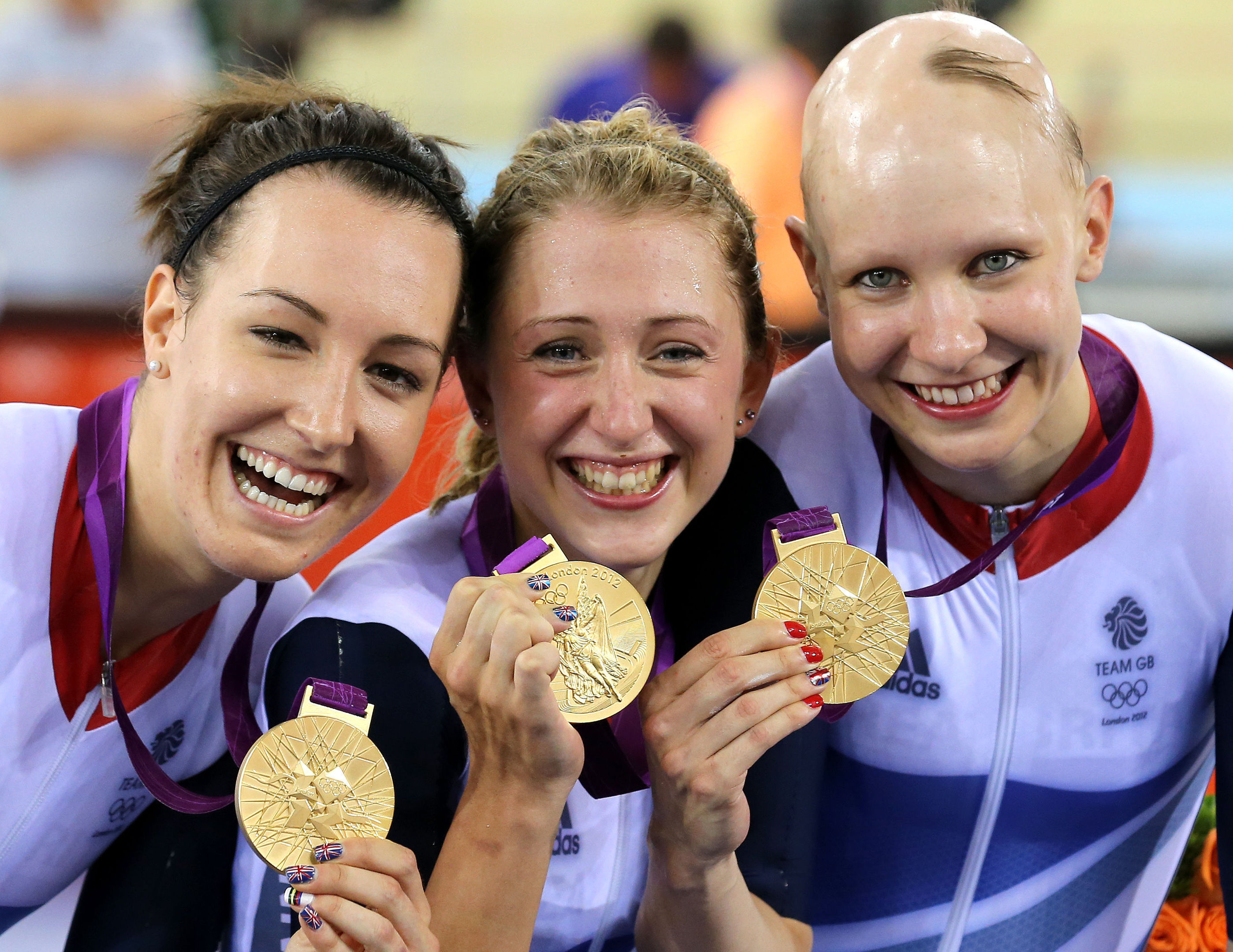 Great Britain's (left to right) Dani King, Laura Trott and Joanna Rowsell celebrate with their gold medals (Andrew Milligan/PA Wire.)