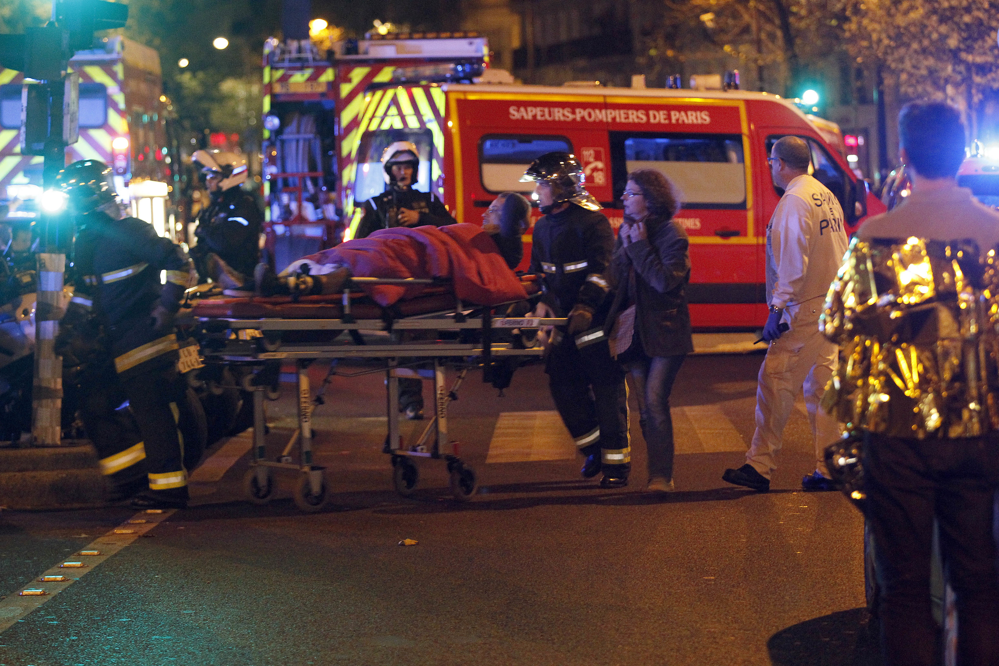 Medics move a wounded man near the Boulevard des Filles-du-Calvaire after an attack November 13, 2013 in Paris, France. (Thierry Chesnot/Getty Images)