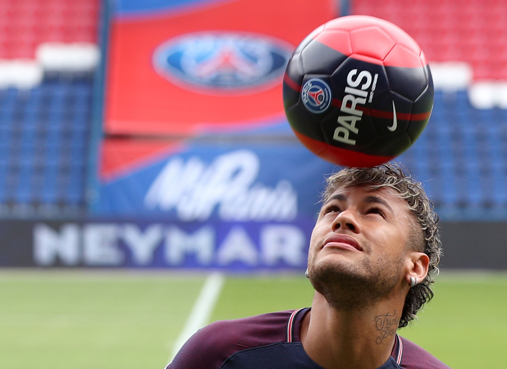 Neymar performs skills pitchside after a press conference at the Parc des Princes (PA)