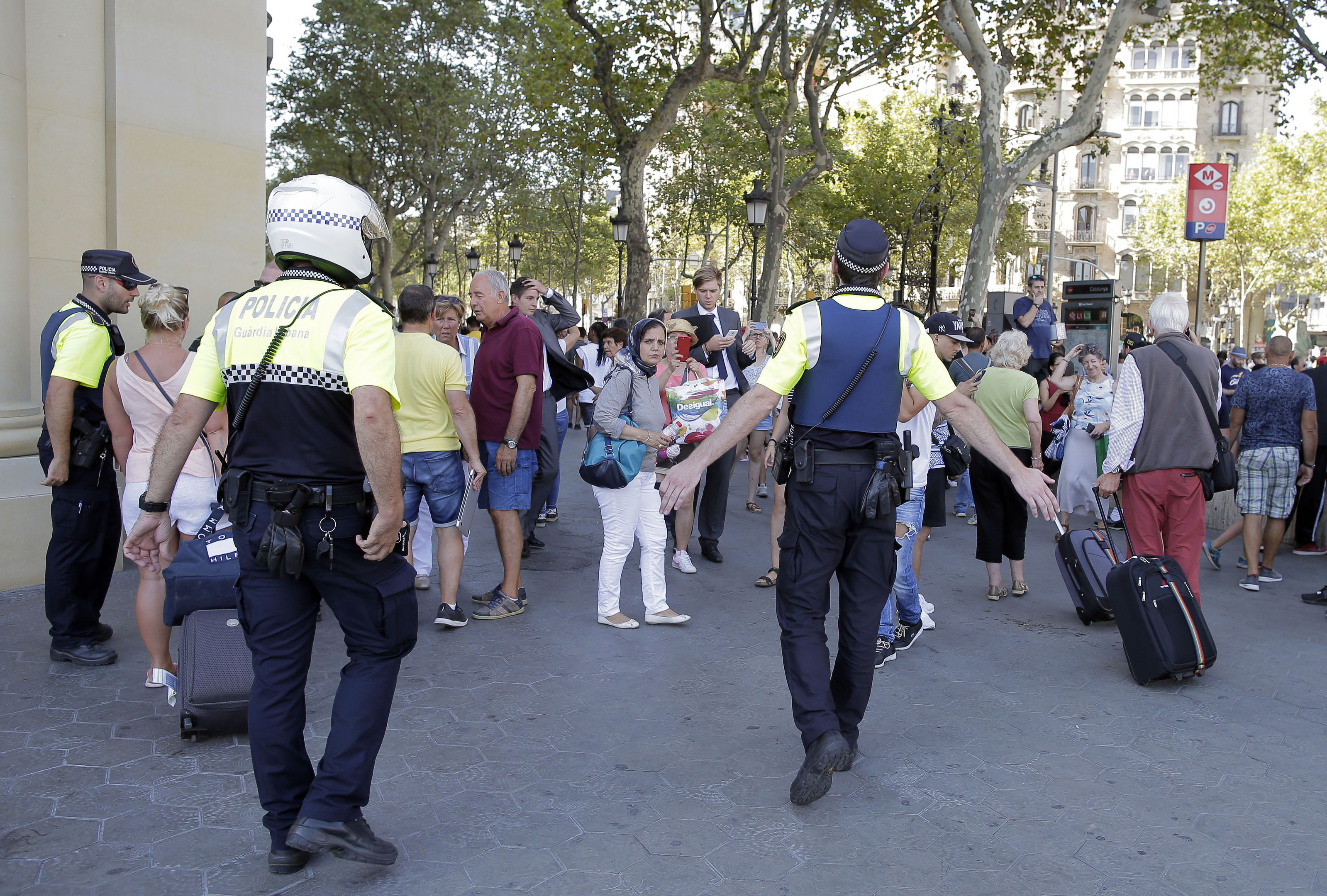 Police officers tell members of the public to leave the scene (AP Photo/Manu Fernandez)