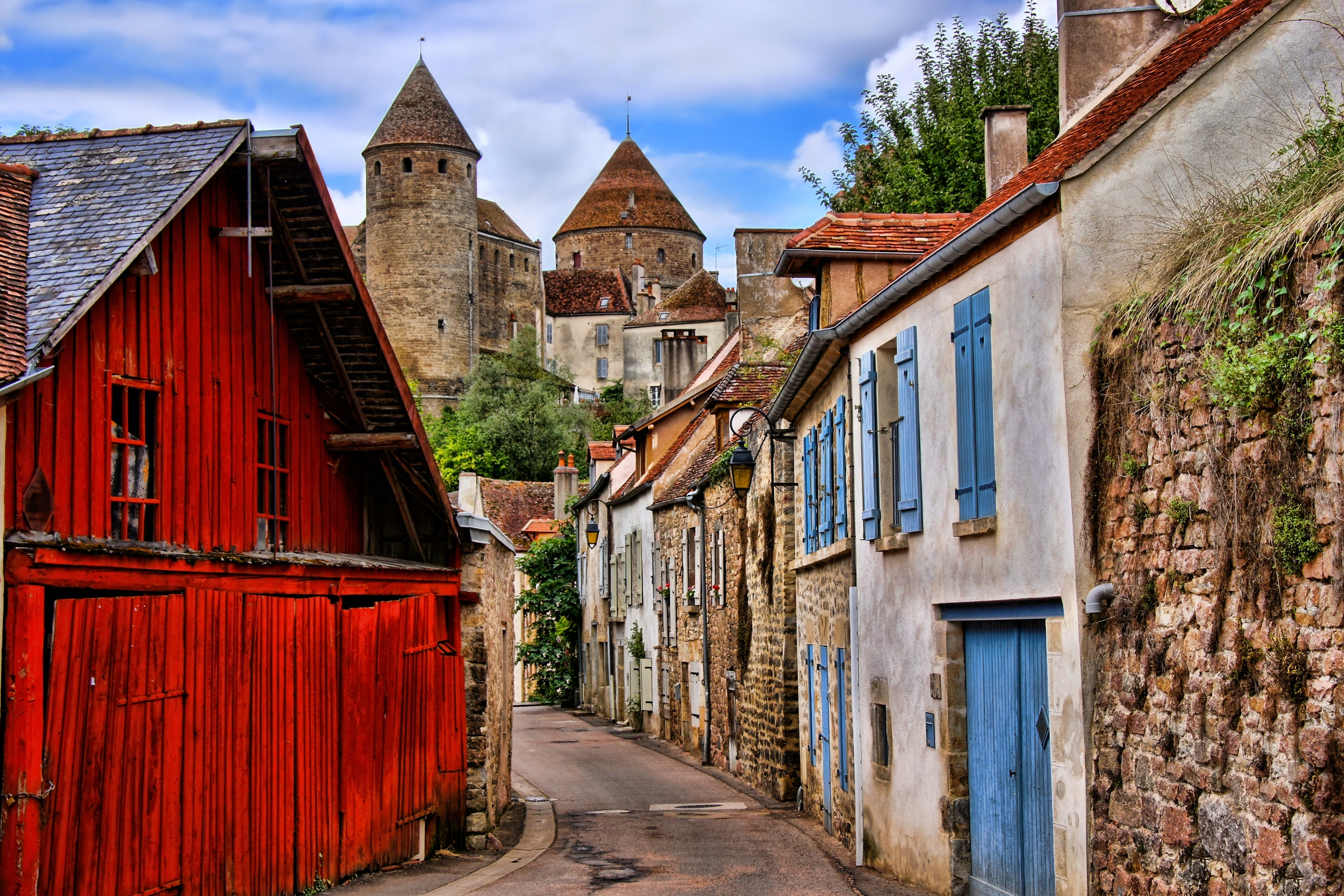 Old picturesque lane with medieval towers in the village of Semur en Auxois, Burgundy, France (iStock)