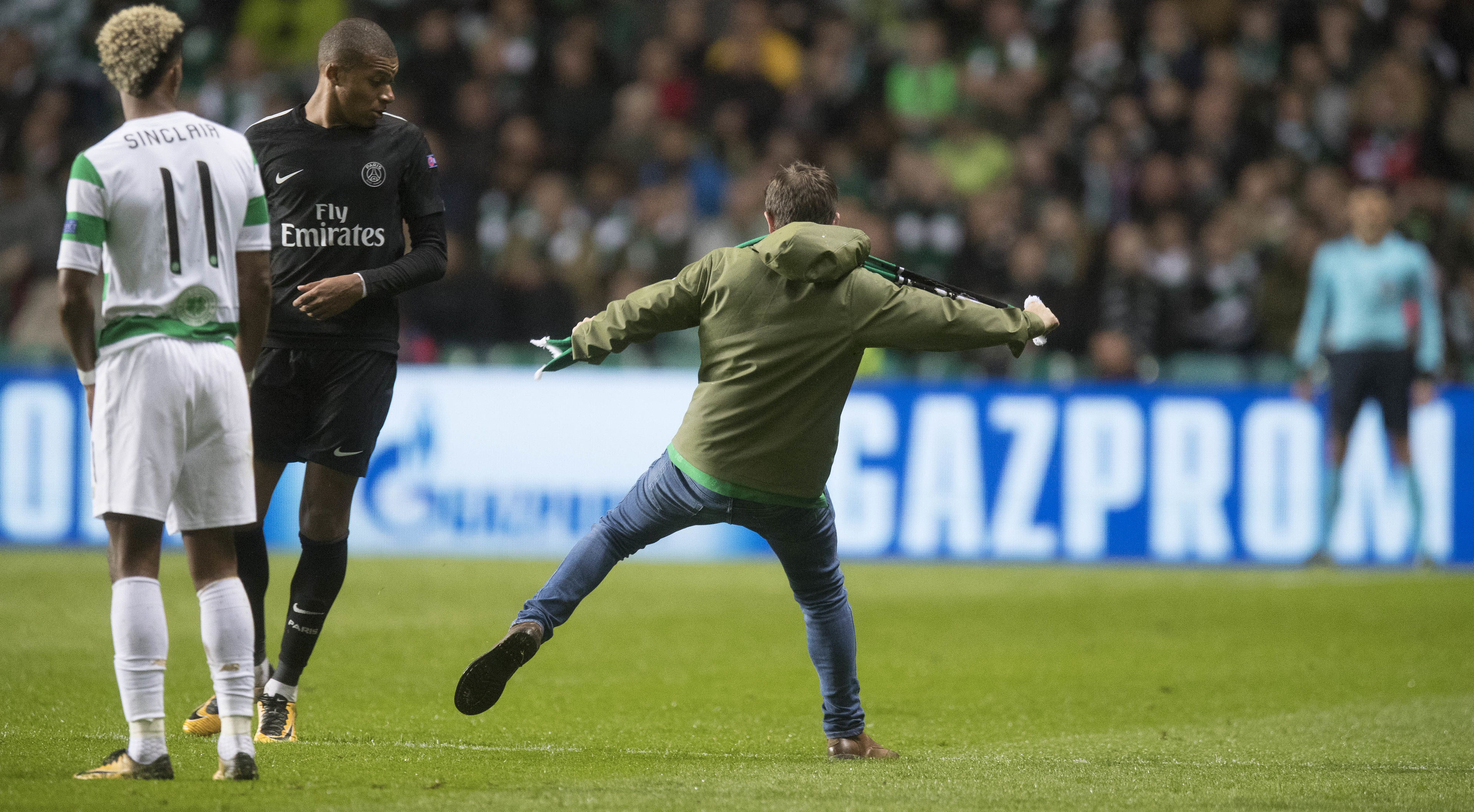 A Celtic fan ran on the pitch and aimed a kick at Kylian Mbappe (Steve Welsh/Getty Images)