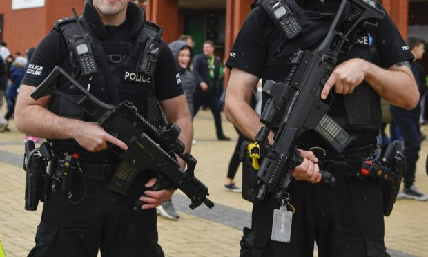 Armed Police patrol outside Celtic Park for a match earlier this season (SNS Group)