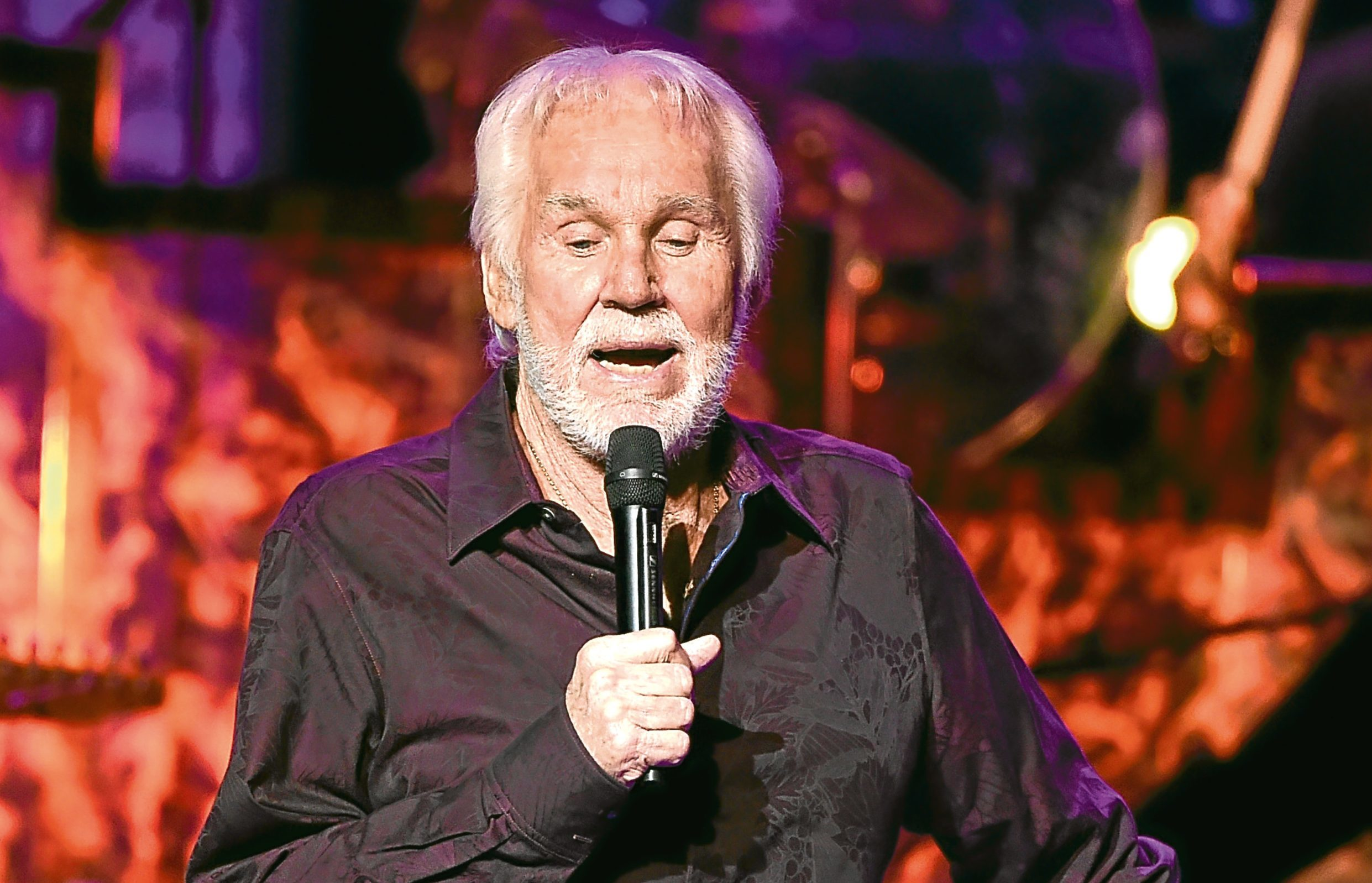 """Kenny Rogers performs onstage during his final world tour """"The Gambler's Last Deal"""" (Kevin Winter/Getty Images)"""