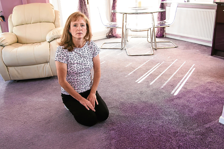Carol Matthews with old carpet for Raw Deal. (Tina Norris)