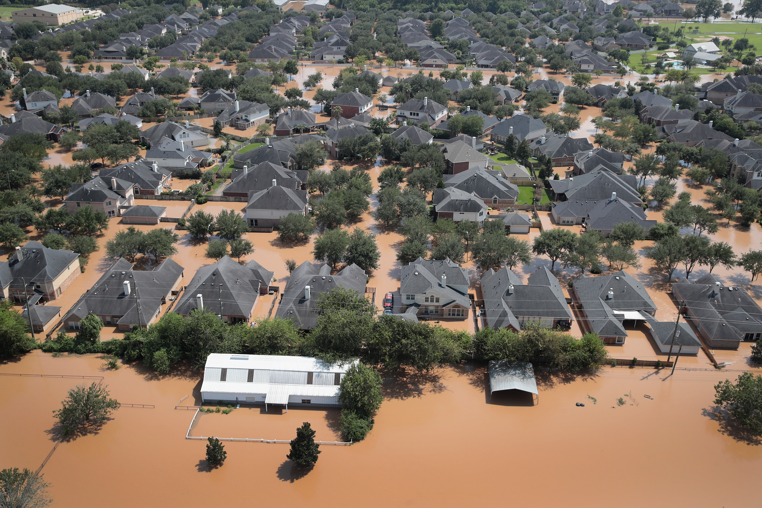 Homes are surrounded by floodwater after torrential rains pounded Southeast Texas following Hurricane and Tropical Storm Harvey  (Scott Olson/Getty Images)