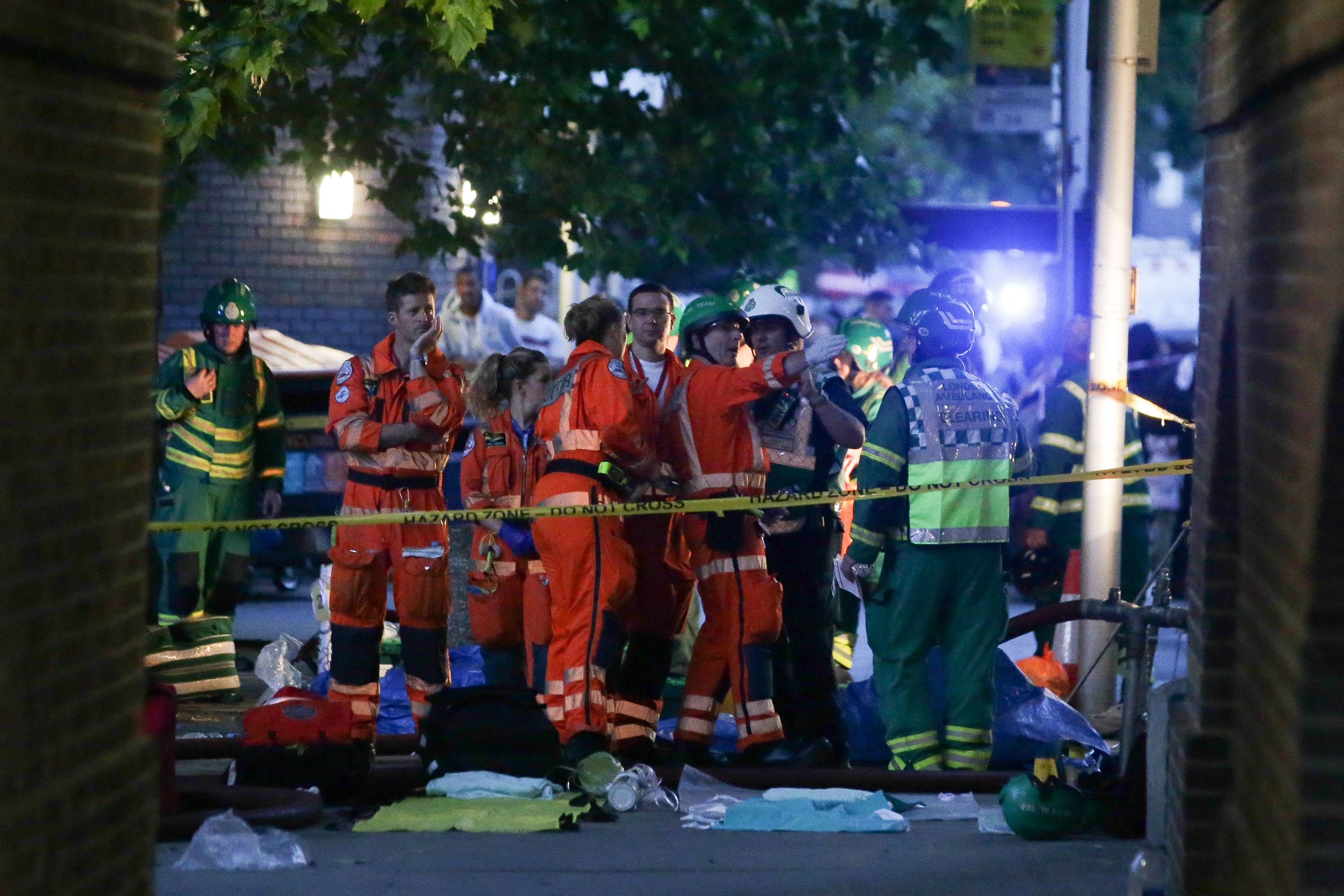 Paramedics working at the scene ned to a huge fire at Grenfell Tower, in west London on June 14, 2017. (DANIEL LEAL-OLIVAS/AFP/Getty Images)