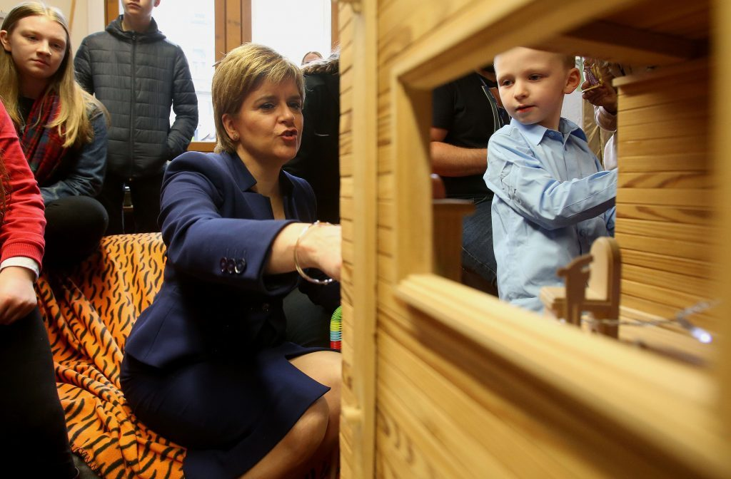 First Minister Nicola Sturgeon with six-year-old Angus Armstrong at the launch of a new young carers grant at Edinburgh Young Carers Project. (Gordon Terris/The Herald/PA Wire)
