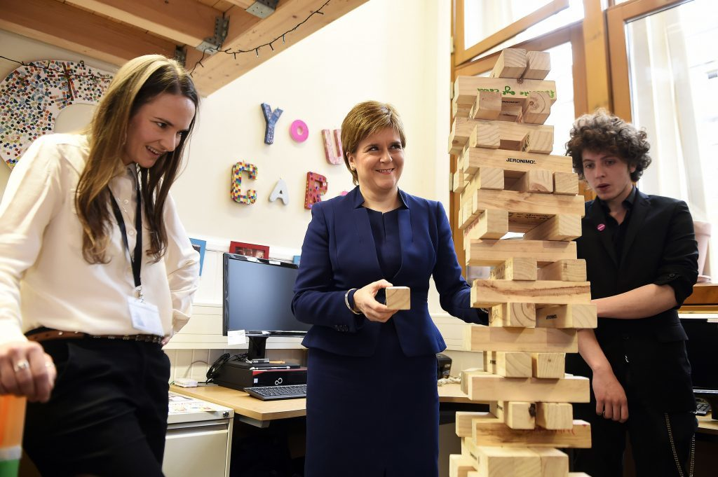 First Minister Nicola Sturgeon playing jenga at the launch of a new young carers grant at Edinburgh Young Carers Project. (Andy Buchanan/PA Wire