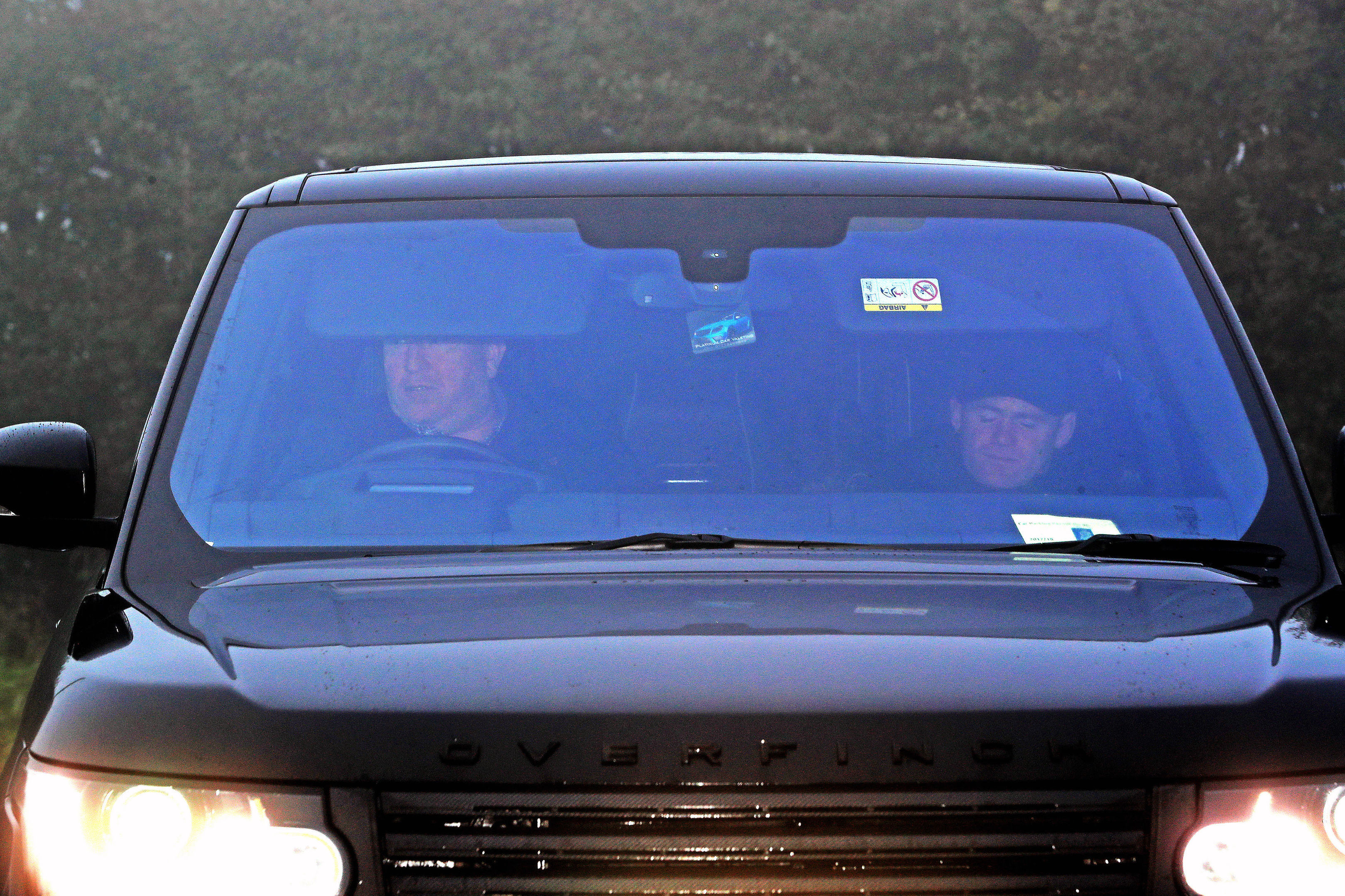 Wayne Rooney is driven in to Everton's Finch Farm Training Ground, after being banned from driving for two years and ordered to perform 100 hours of unpaid work as part of a 12-month community order. (Peter Byrne/PA Wire)