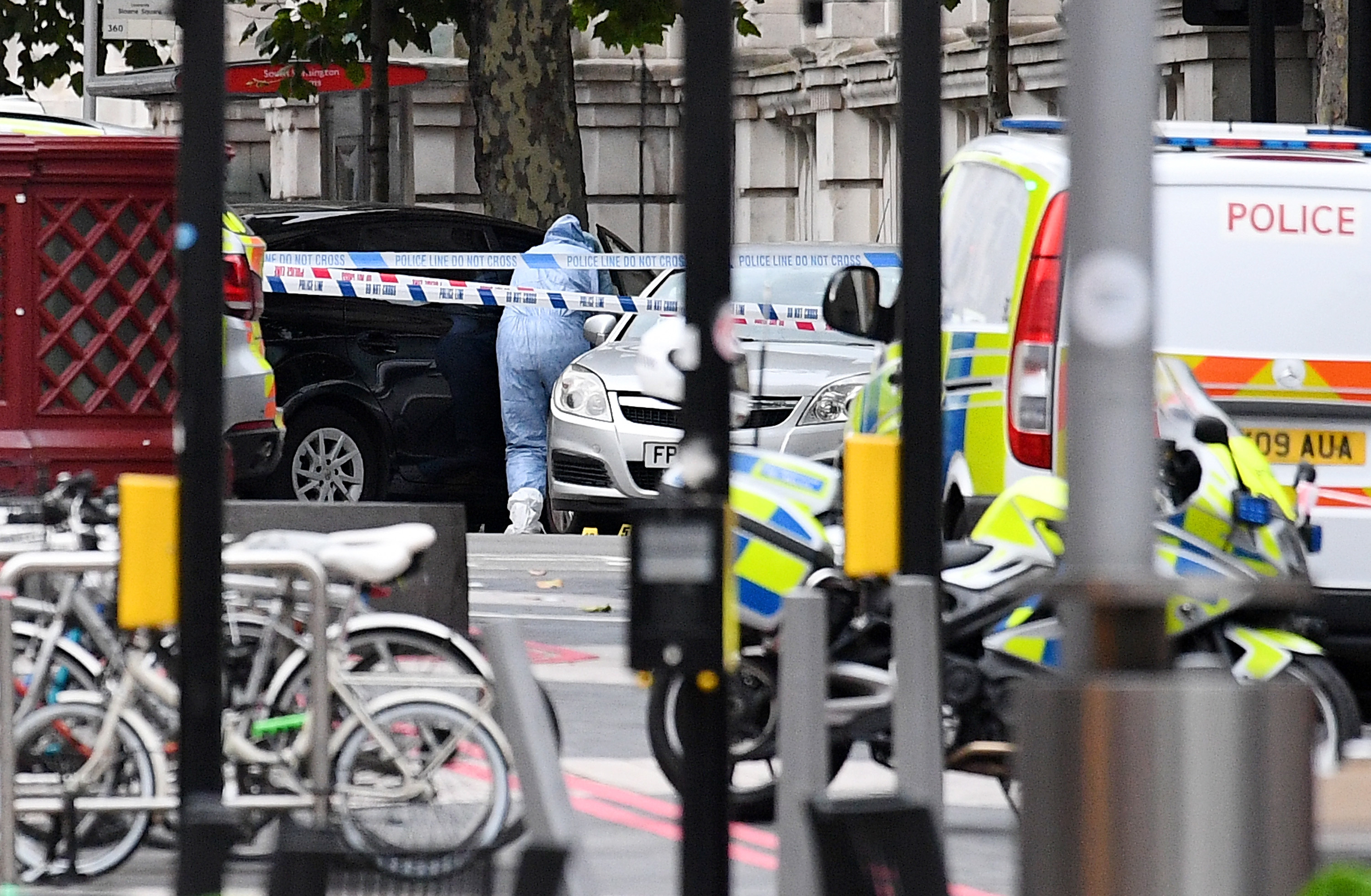 A scenes of crime officer enters a vehicle which is believed to be the car that mounted the pavement and collided with pedestrians outside the Natural History Museum (Leon Neal/Getty Images)