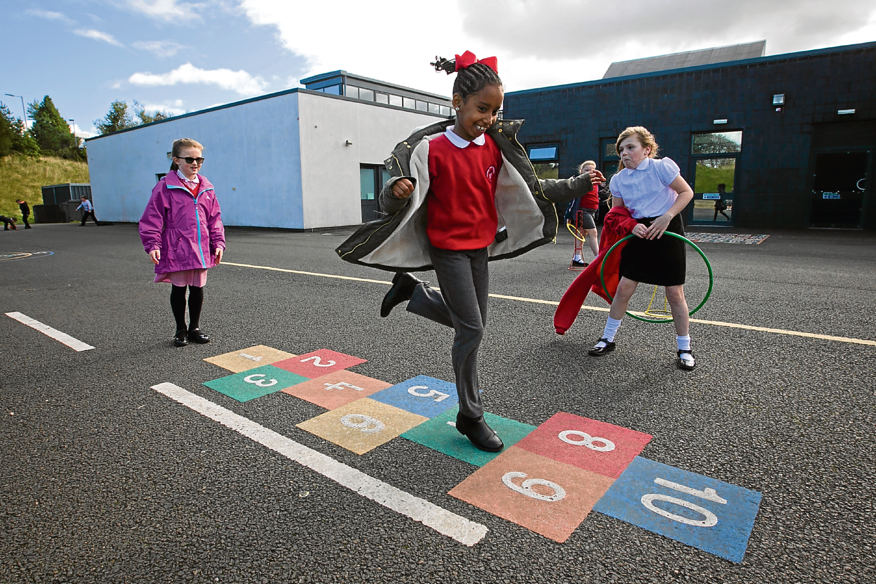 School children playing various outdoor games at Avenue End Primary School, near Easterhouse, in Glasgow (Andrew Cawley / DC Thomson)
